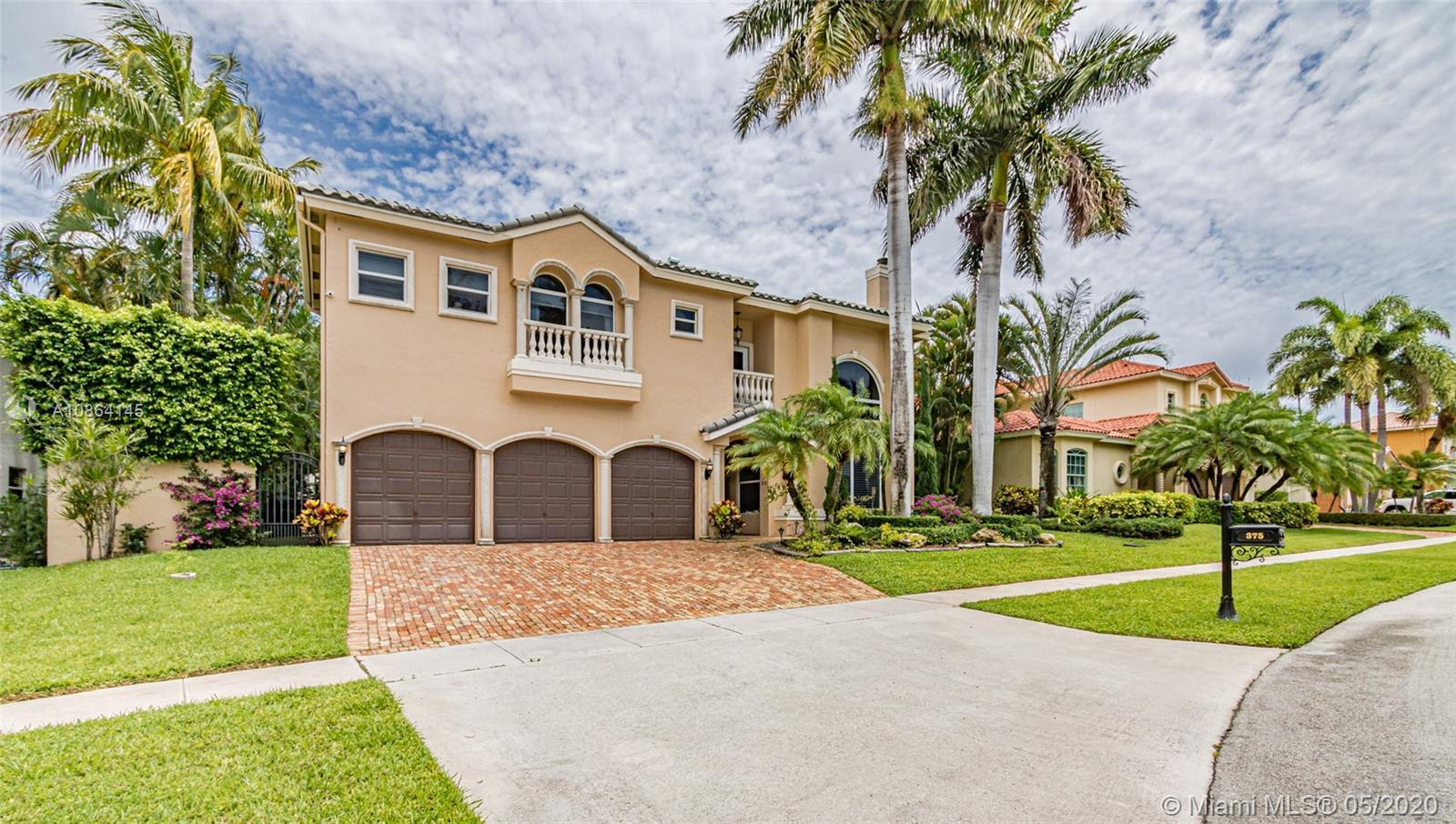 Stunning upgraded 2 story 5/4 Mediterranean villa with courtyard in desirable gated Boca East Estate