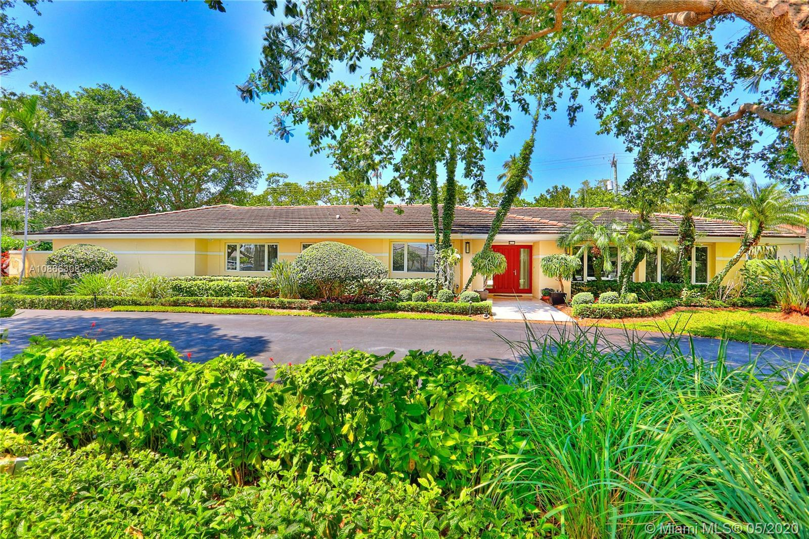 This home is ideally situated in the guard-gated community of Hammock Oaks & backs up to beautiful F