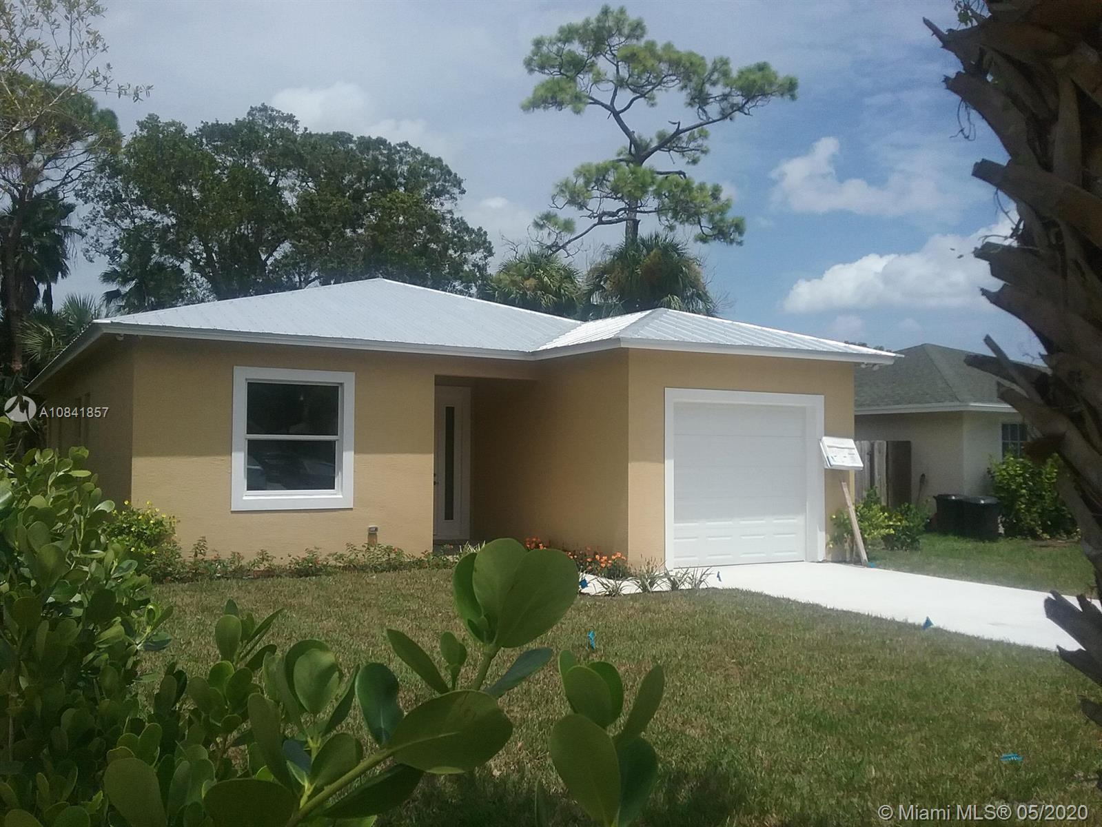 REDUCED! Upgraded Newer Jupiter 3 bedroom 2 baths 1470 Sq./Ft home with open floor plan, 10ft ceilin