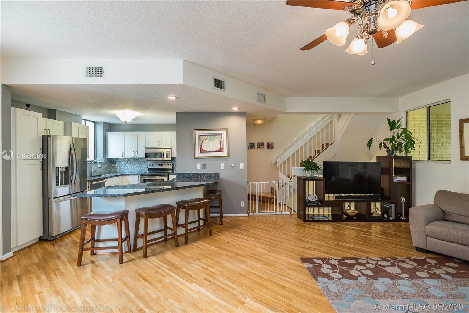 This tri-level townhouse in the exclusive gated neighborhood of Victoria Park Place is ideally locat