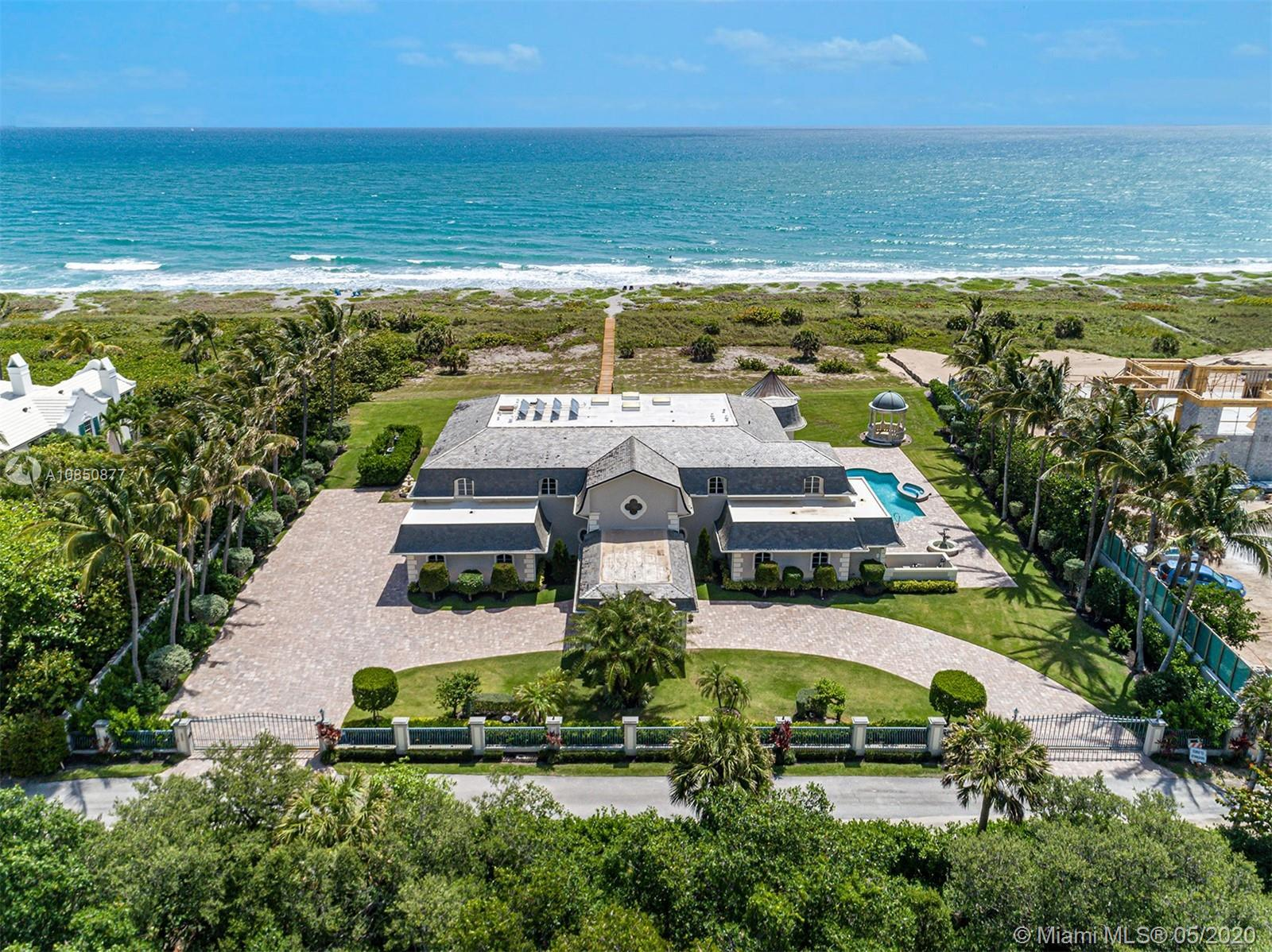 Spectacular oceanfront estate located on 2.62 acres on the south end of stunning Jupiter Island! A p