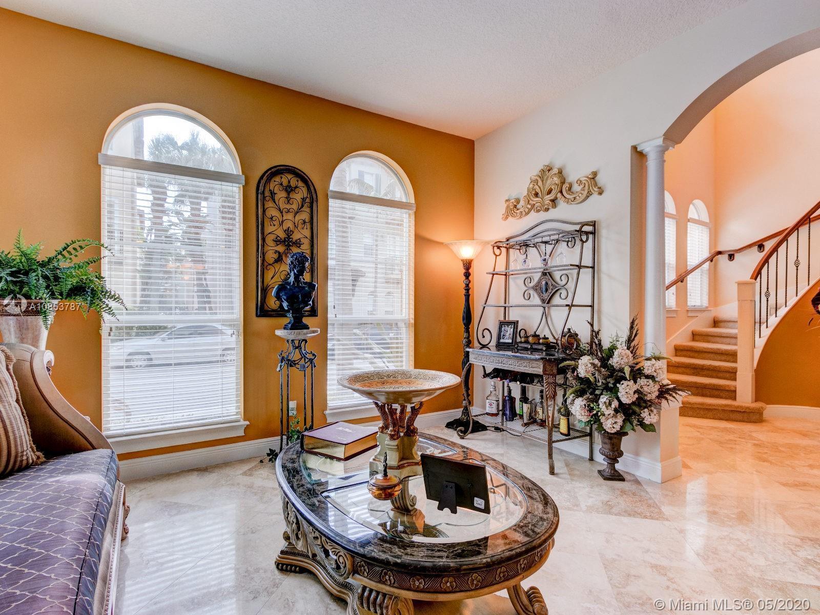 Corner Lot! Elegant east Boca home. Highly desired Solana model. Soaring 2 story foyer entrance with