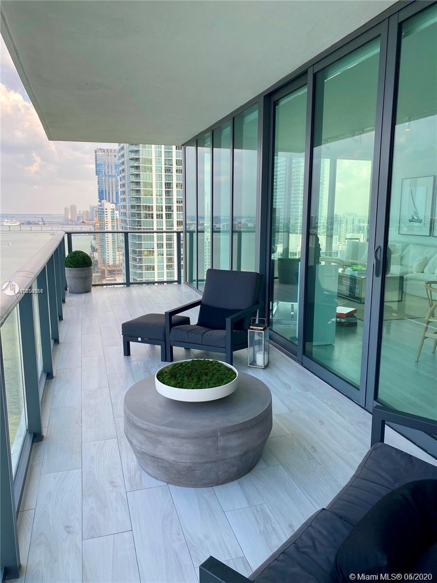 Enjoy this 3 Bedroom 3 and 1/2 bath gem at highly desired One Paraiso Condominium. Unit with floor t