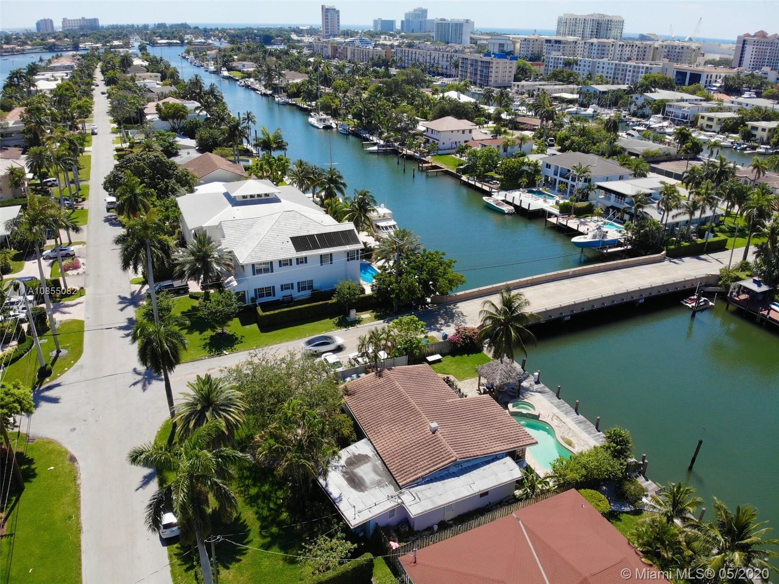 "BOATERS AND YACHT OWNERS TAKE NOTICE!! EXCELLENT OPPORTUNITY TO BUY THIS WATERFRONT RESIDENCE IN THE HEART OF LAUDERDALE HARBORS ON 80"" OF DEEP-WATER AND EITHER REMODEL OR CONSTRUCT A NEW HOME. EXTREMELY CLOSE OCEAN ACCESS AND LOCATED ON A WIDE CANAL CAN ACCOMMODATE A CATAMARAN OR SEVERAL BOATS STERN TO DOCK FOR YOUR BAHAMIAN GETAWAY. ONLY ONE CANAL AWAY FROM THE ENTRY TO PORT EVERGLADES AND OCEAN. ENJOY THE SOUTHERN EXPOSURE POOL & SPA. ROOF NEW IN 2006, HEAT REFLECTIVE TILES AND INSULATED. UPDATED INTERIOR 2 MASTER SUITES. OPEN FLOOR PLAN. WALK TO LOCAL PUBS, SHOPS AND FINE DINING. THE EXISTING 2 BEDROOM/ 3 BATHS 1917 SQ. CORNER POOL HOME ON SITE COULD FEASIBLY BE RENOVATED!! EASY TO SHOW."
