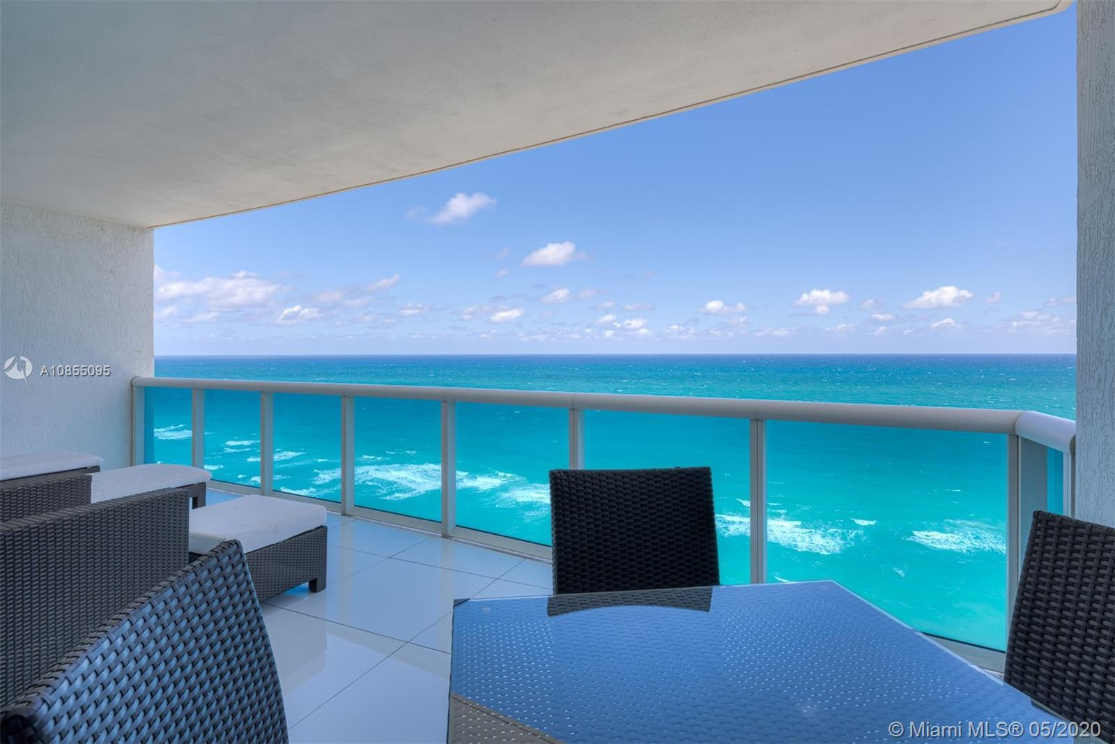 Impeccable fully furnished residence with direct ocean views. Wonderful flow-through floorplan with