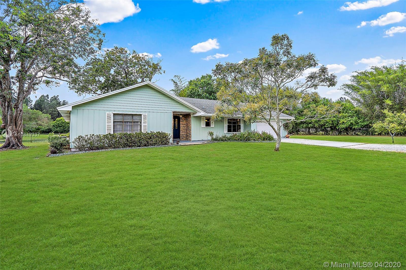 This 5.99 Acre - 4 Bedroom, 3 Bath House in Jupiter Farms has a Horse barn with 4 stalls and an addi