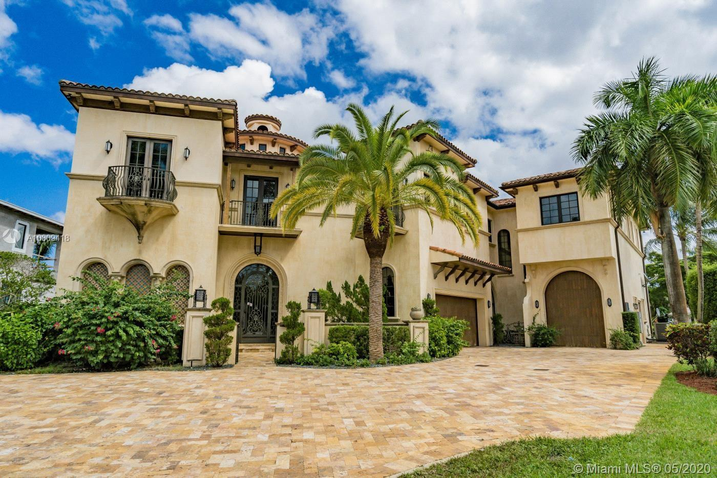 Welcome to St. Andrews Country Club and this majestic Spanish Renaissance luxury masterpiece. Luxury