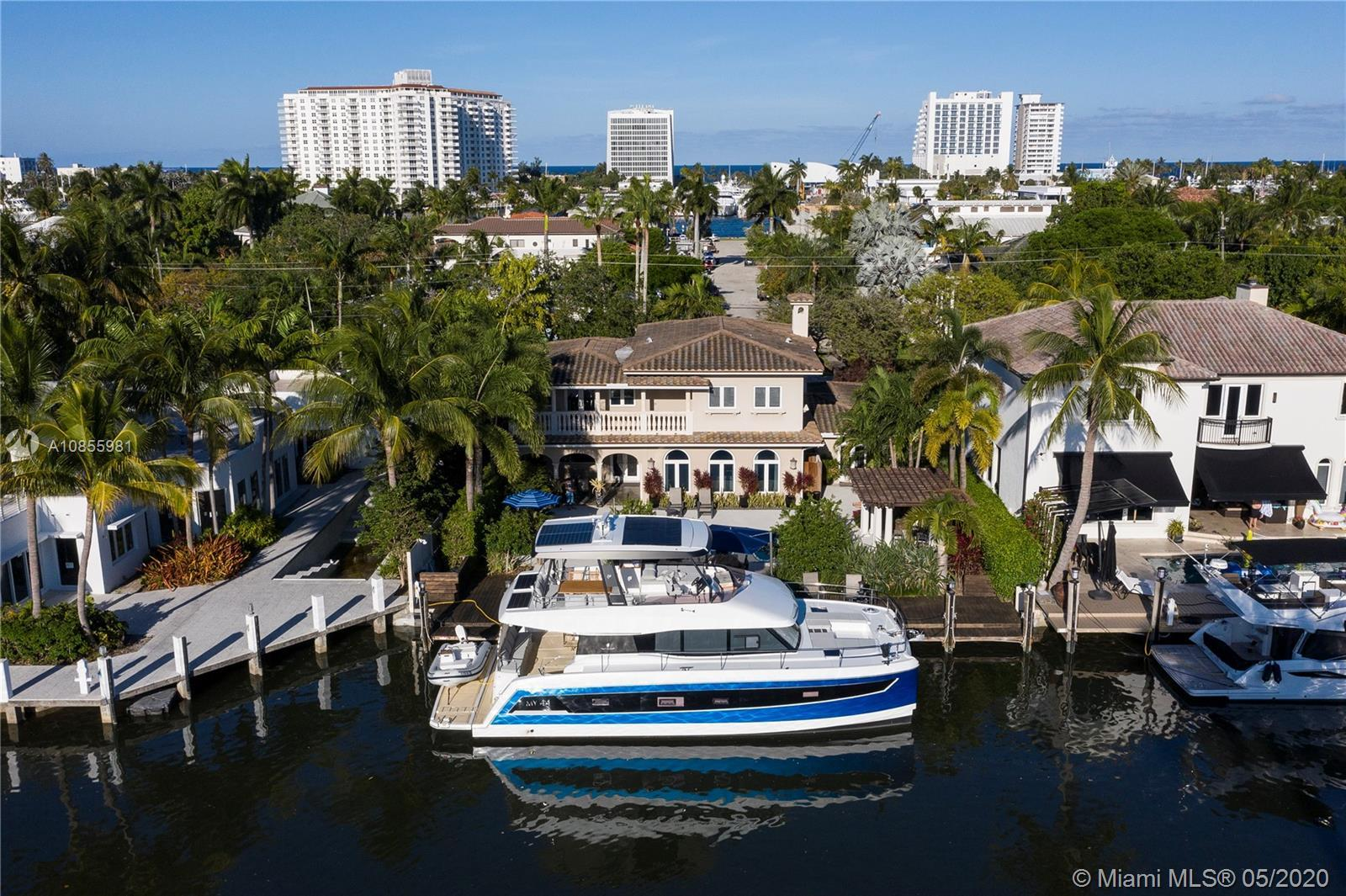 Walk to the beach and the restaurants from this desirable Las Olas Isles waterfront home in the Idle