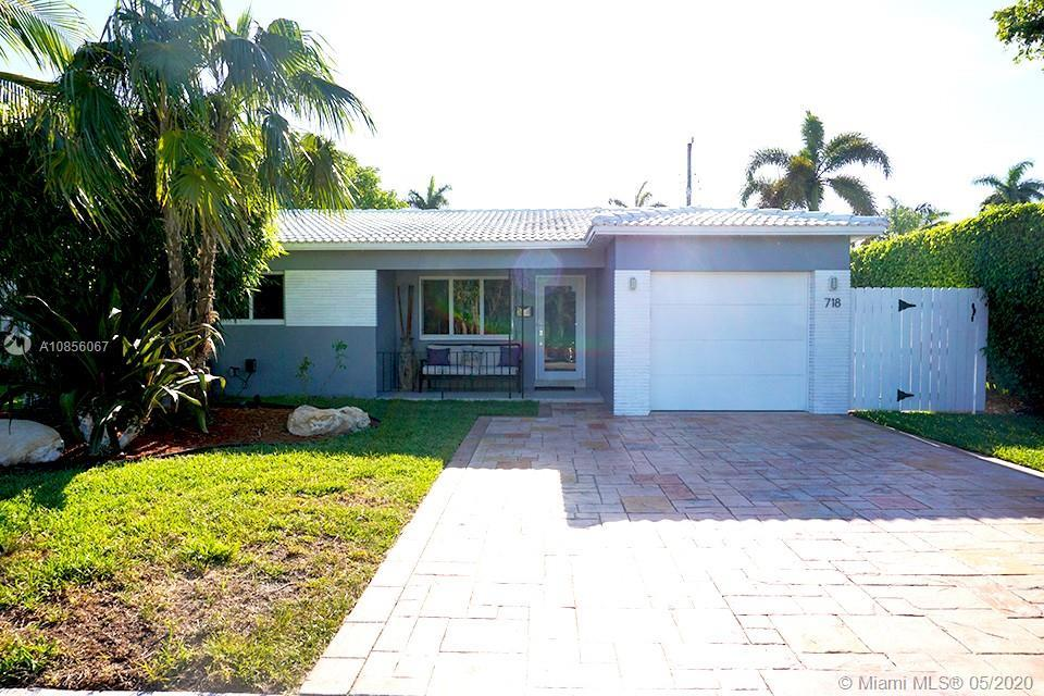 Charming 2 bedroom, 2 bath home with open space design. Custom kitchen with wood cabinets and granit