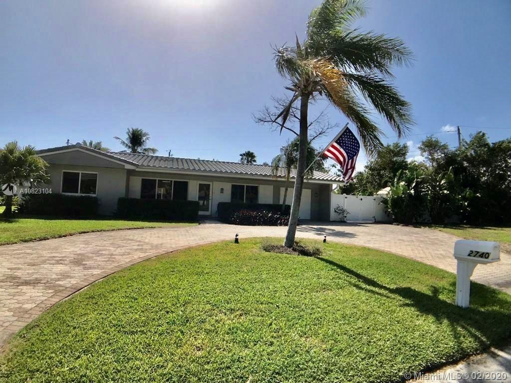 Stunning Lighthouse Point home - bright and sunny, with large open floor plan. Remodeled and freshly