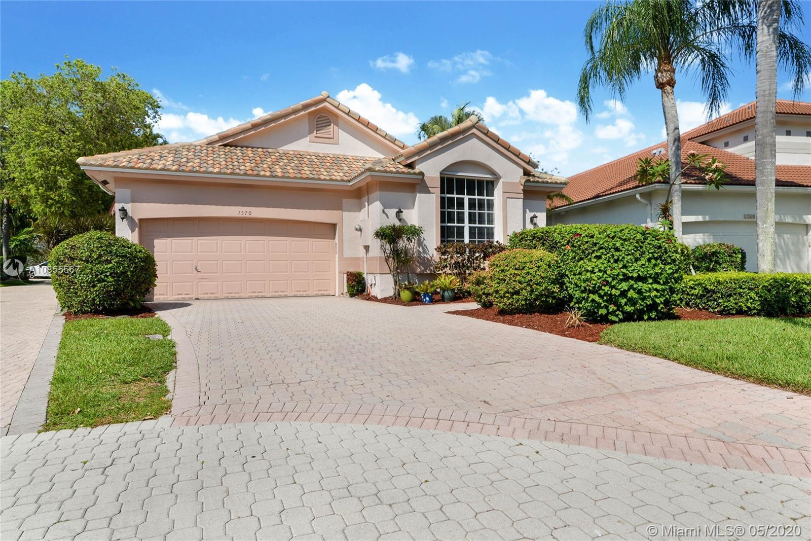 Beautiful home in prestigious Grand Palms community featuring lush landscaping, jogging paths, child