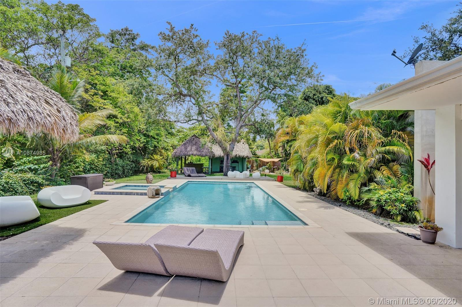 Casual chic corner-gated Estate in prime north Pinecrest location sitting on a 30,927 SF lot. The pr