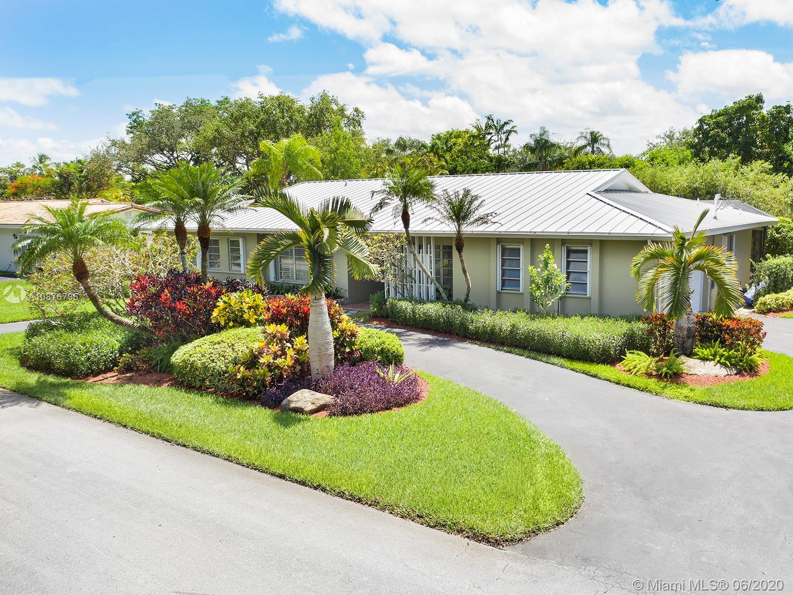 Updated and exceptionally maintained Jennings-built family canal home on coveted Palmetto Island, a