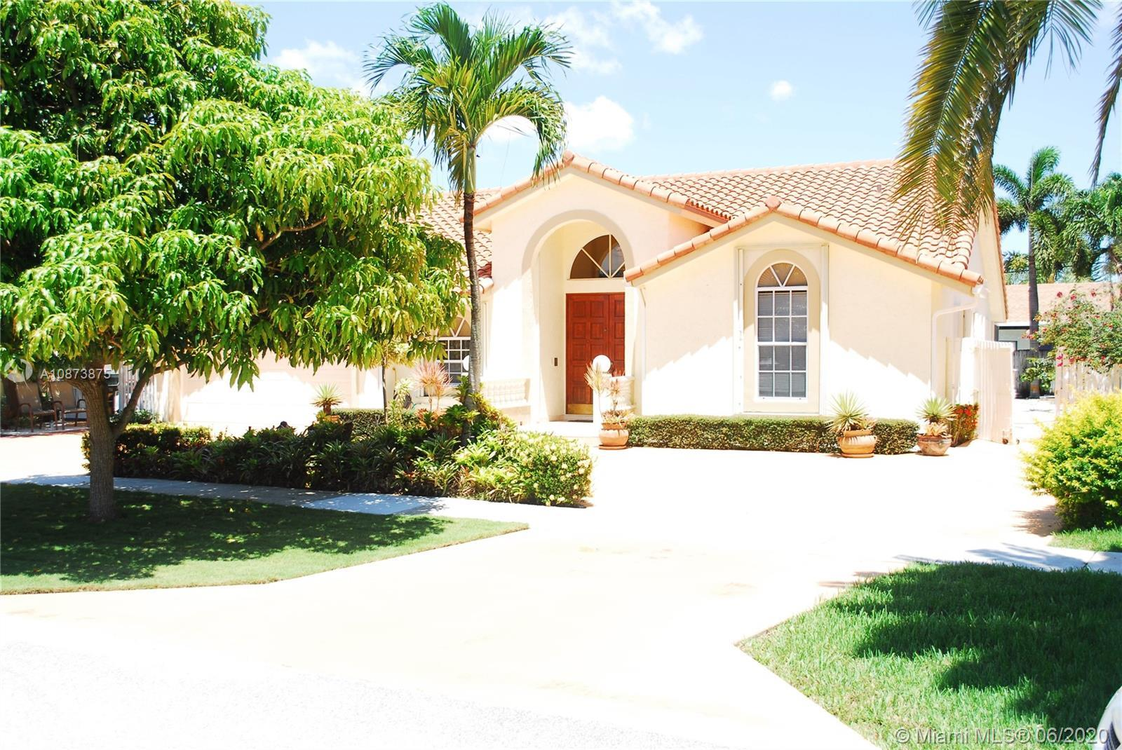 This is a 4/2.5 spacious and well-maintained home with a pool in East Boca's desirable Hidden Valley