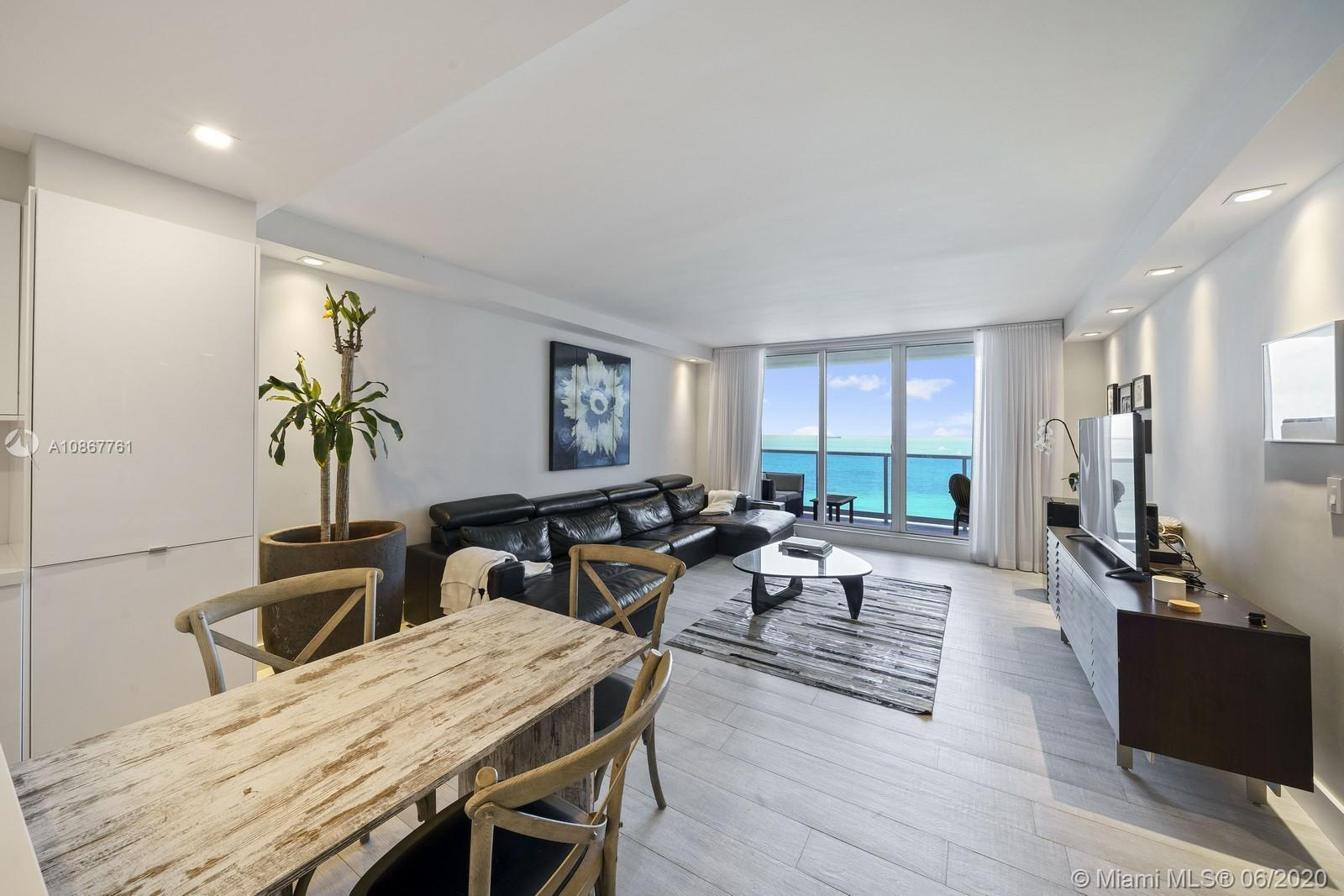 This gorgeous oceanfront unit was combined creating an expansive and luxurious residence with stunni