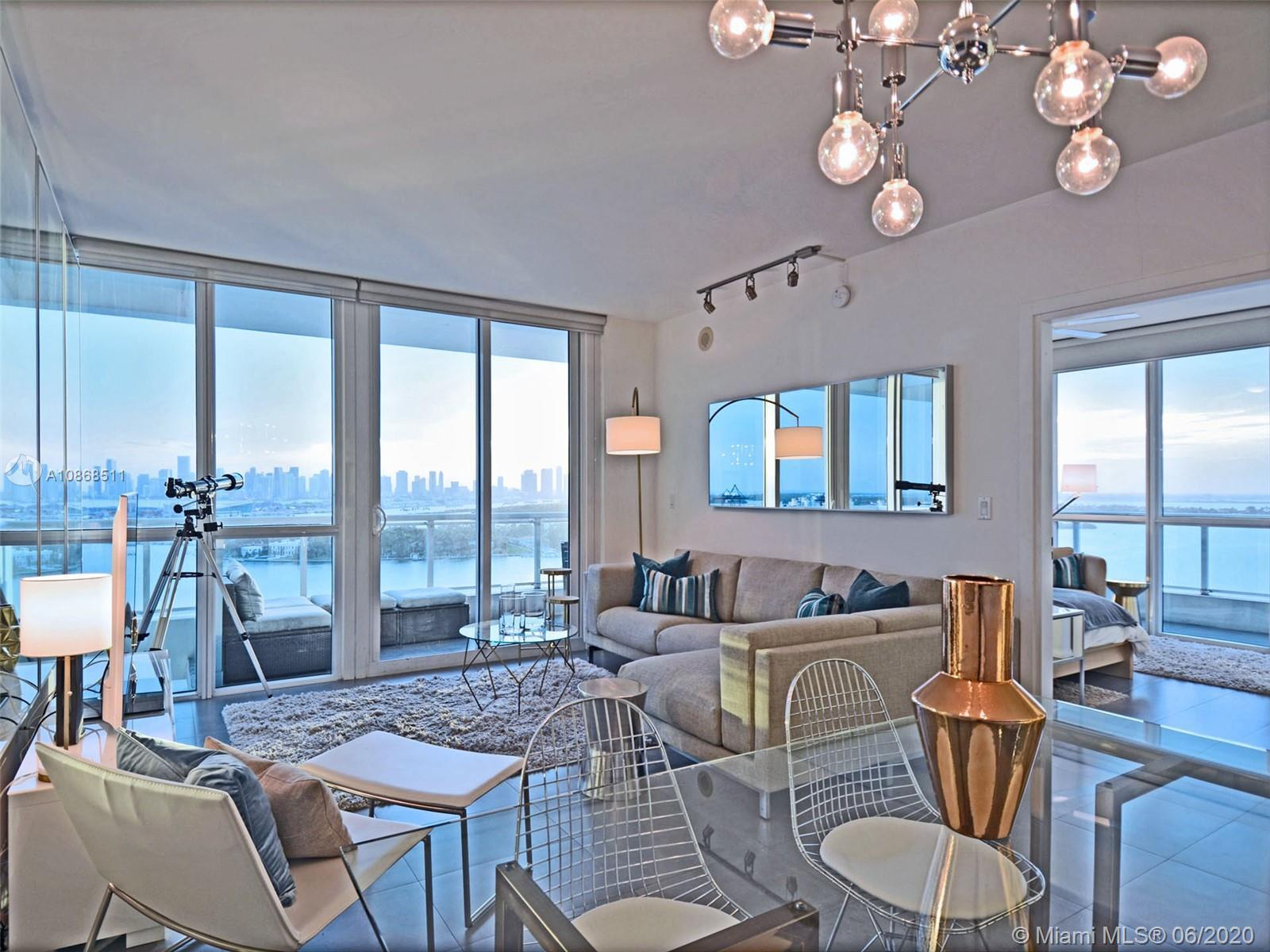 Sitting on the 21st floor in the heart of South Beach and directly on the water, this 2 bed/2 bath c