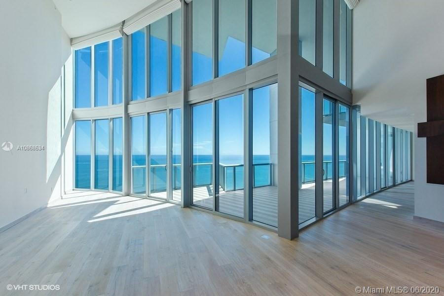 Private elevator leads you to a unique high-end completely remodeled two level Beach front 4BR + mai