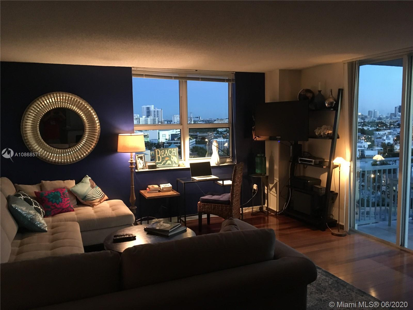 Beautiful corner unit with both bay and ocean views, Brazilian cherry floors and cabinets, stainless