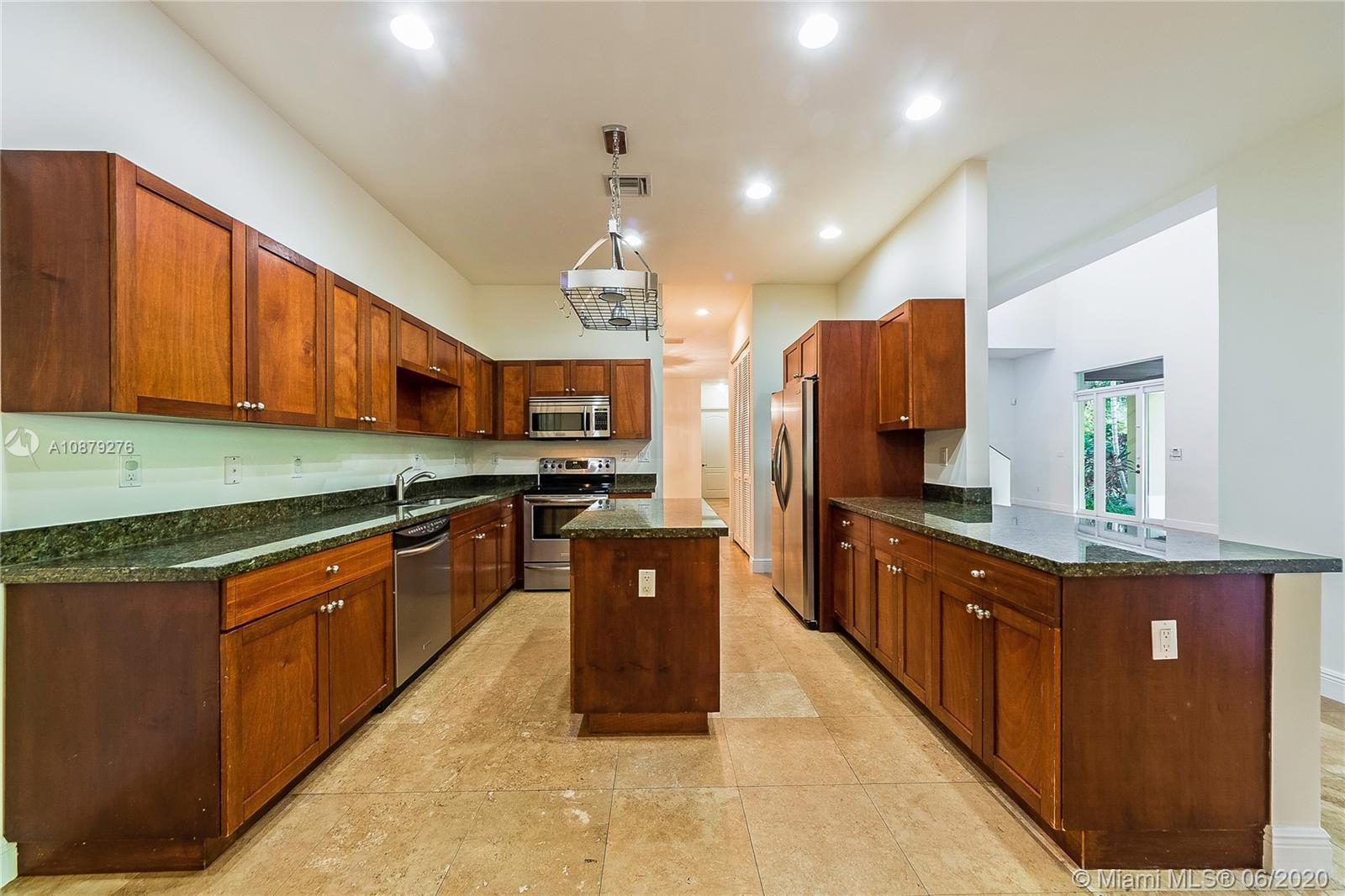 Beautiful and private executive villa built in 2006 in North Pinecrest on very quiet street. This sp