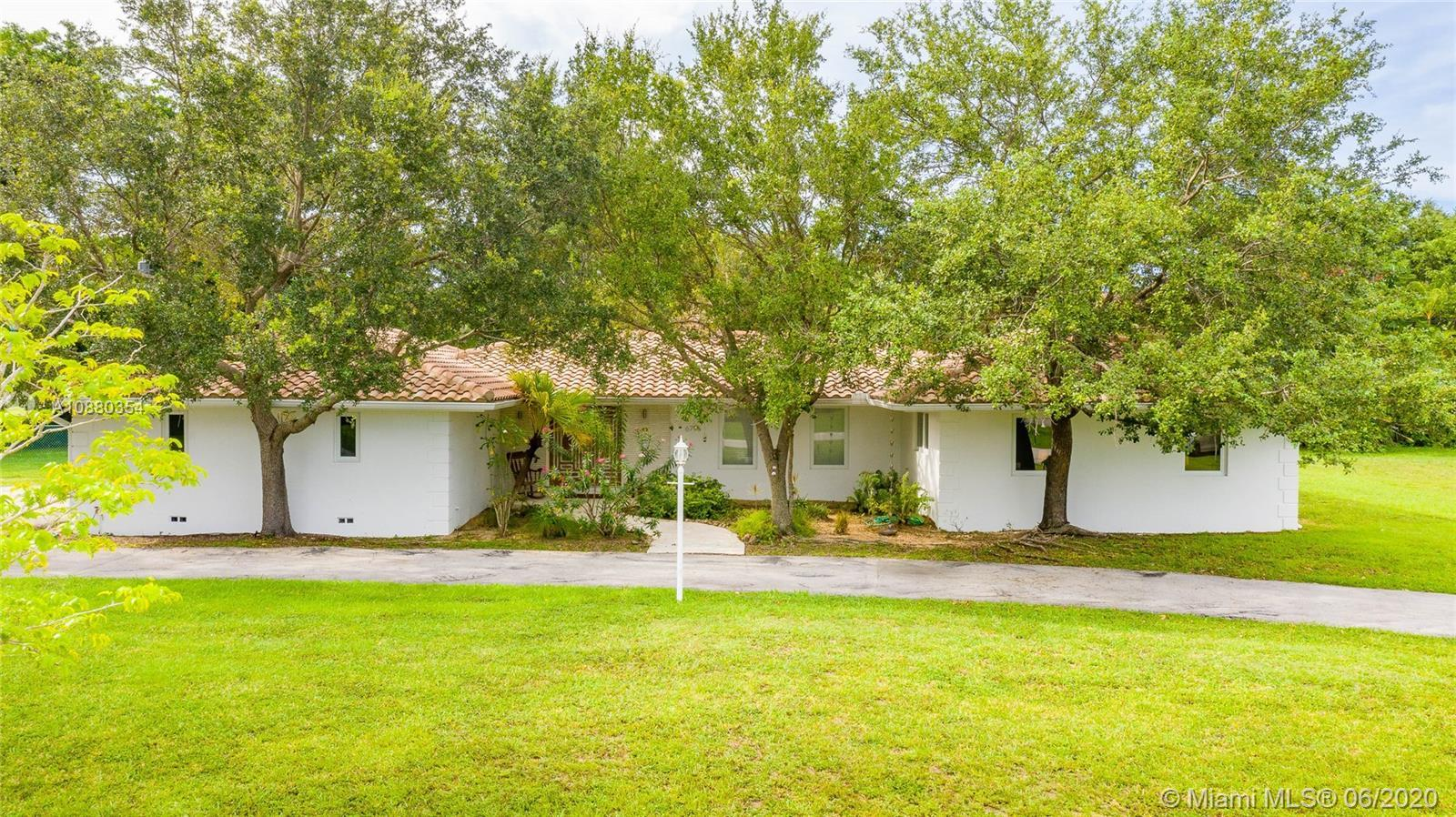 Rarely can you find a home of this caliber for under $1mm in Pinecrest. This spacious and bright hom