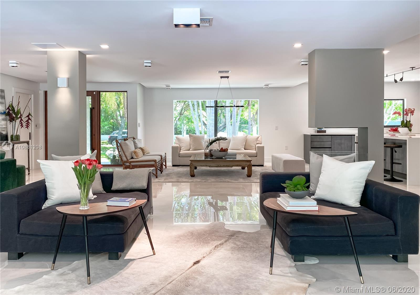 Fully remodeled home in Pinecrest. This residence offers a spacious and bright living area, a state-