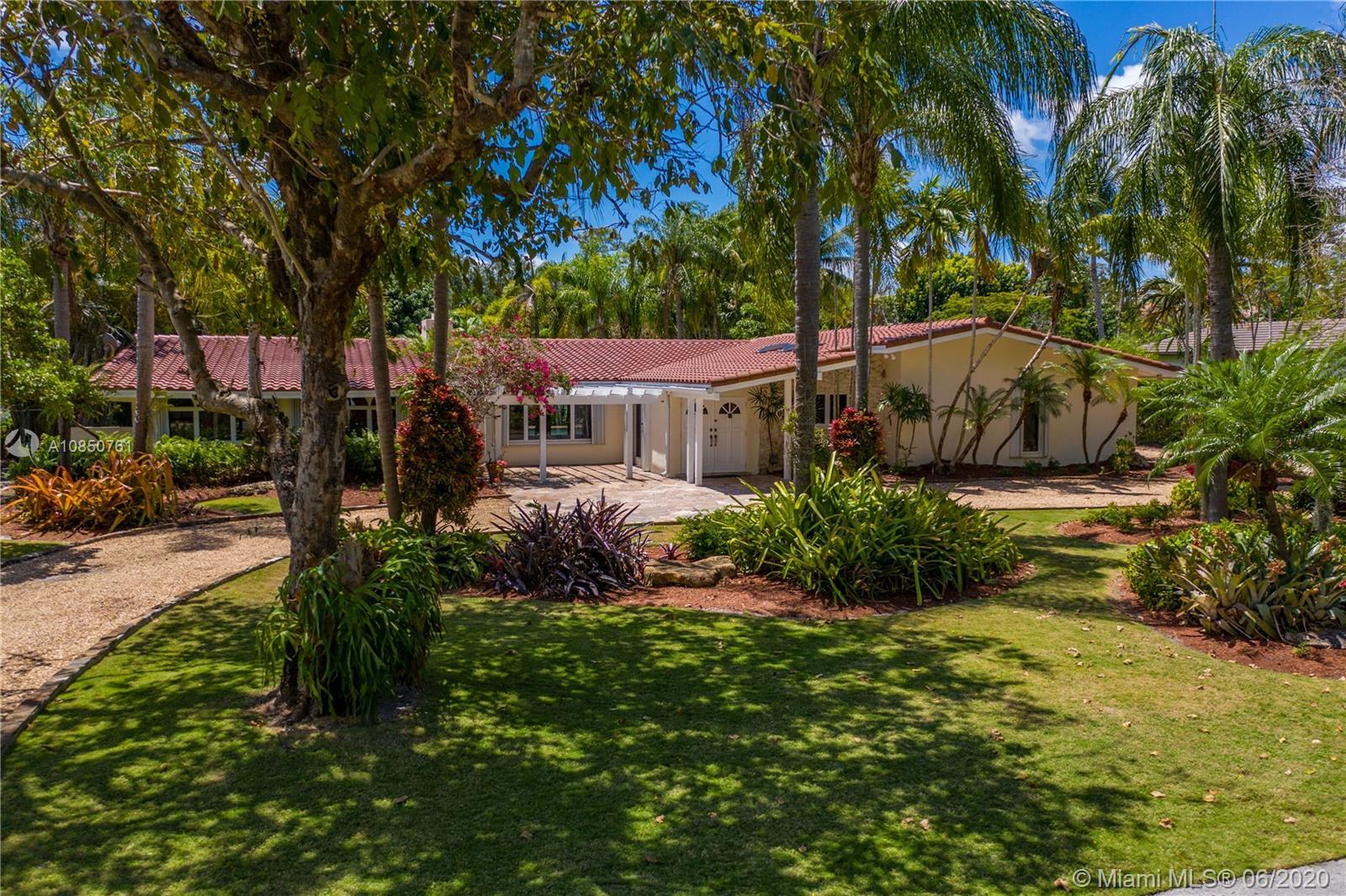 Enjoy a relaxed luxury lifestyle in this Pinecrest family oasis on a deep, private & lushly landscap