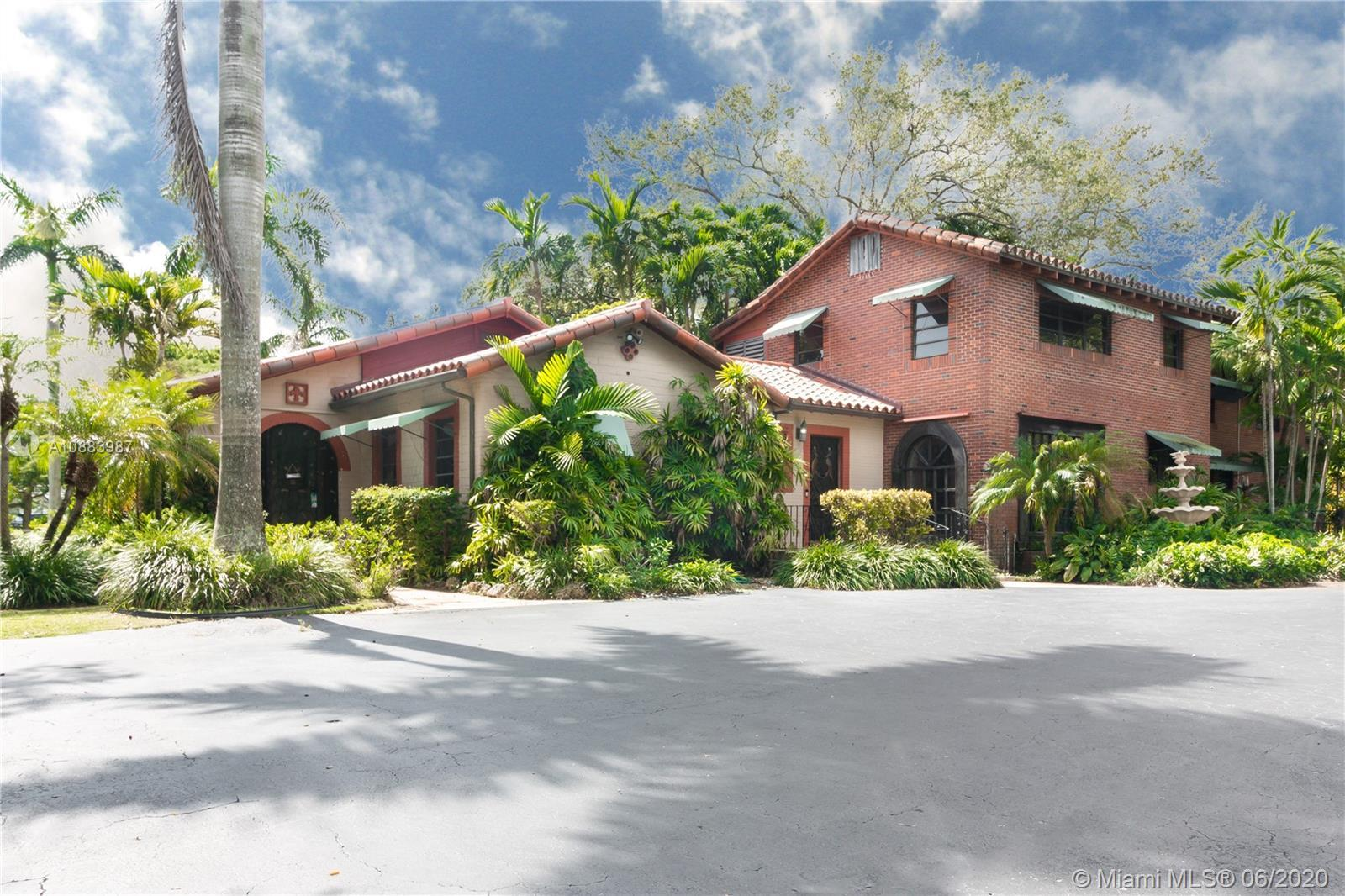 Magnificent Pinecrest Mediterranean estate on a nearly one and a half acre lot in the sought after w