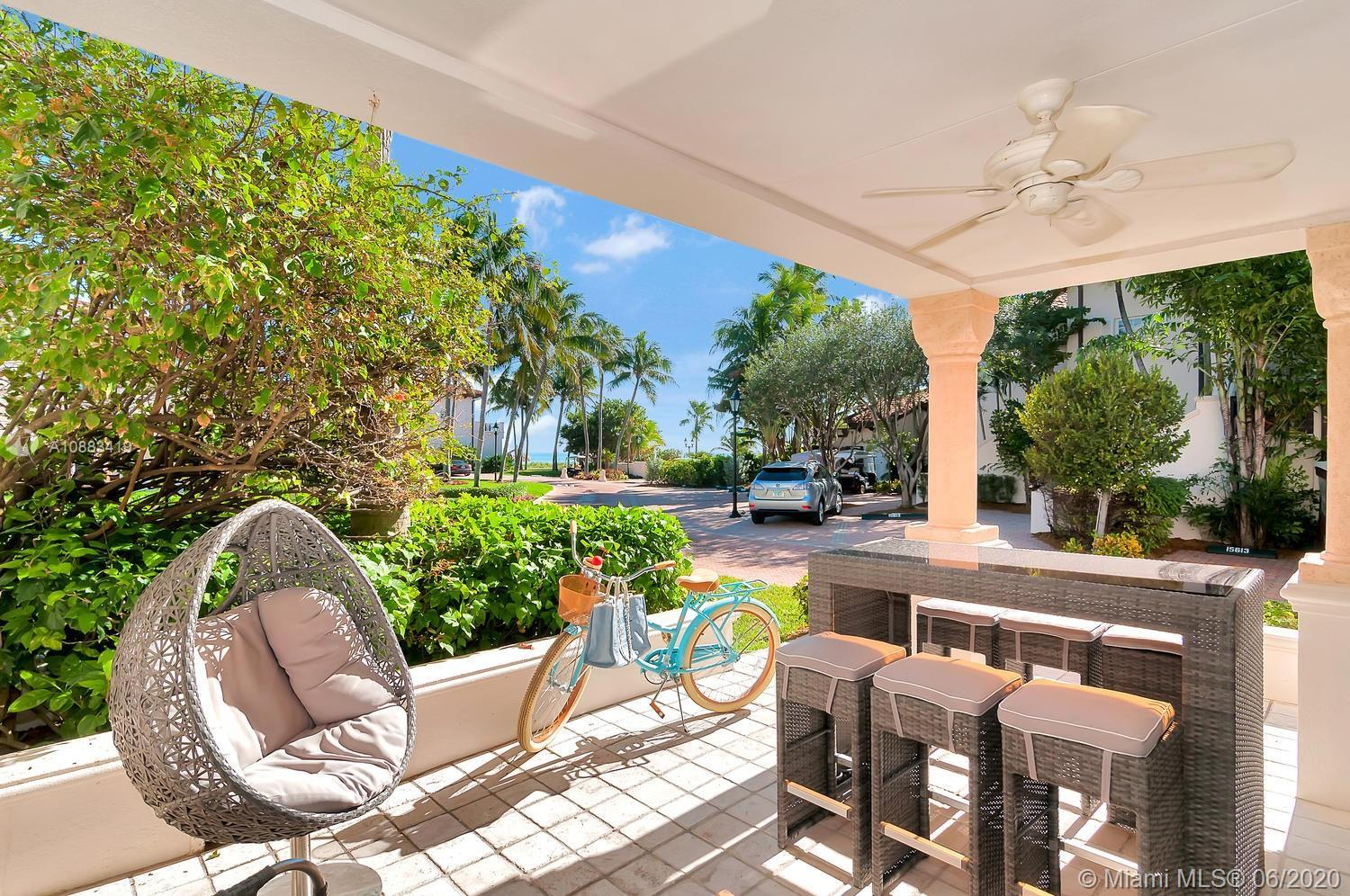 This spectacular Seaside Villa ground floor unit on Fisher Island is just steps away from the ocean