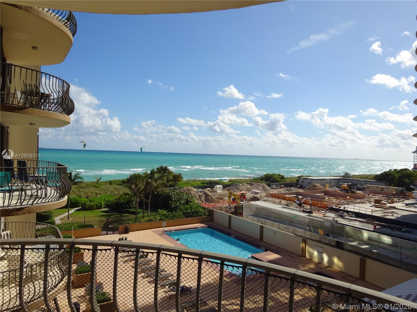 COMPLETELY REMODELED UNIT WITH BREATH TAKING VIEWS of the ocean  and expansive sun filled living spa