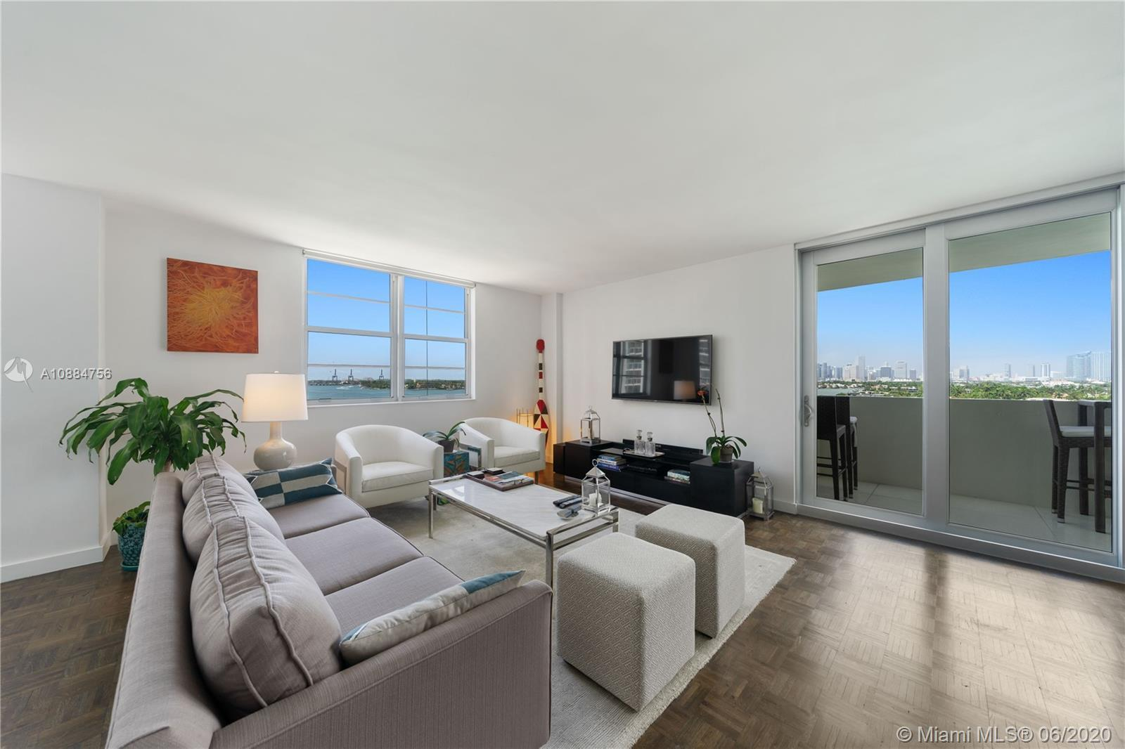 Experience unrivaled views overlooking Biscayne Bay and downtown Miami from this impeccably renovate