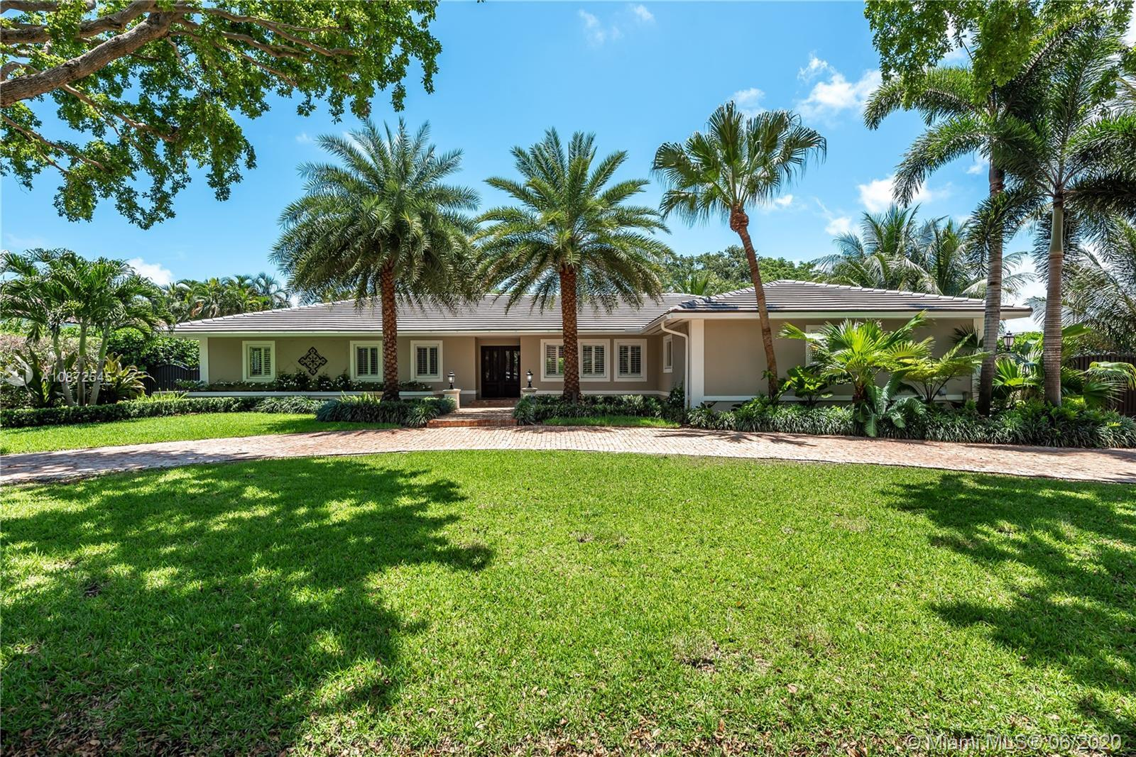 This charming & updated home is located in the guard gated community of Pinecrest By the Sea. Close