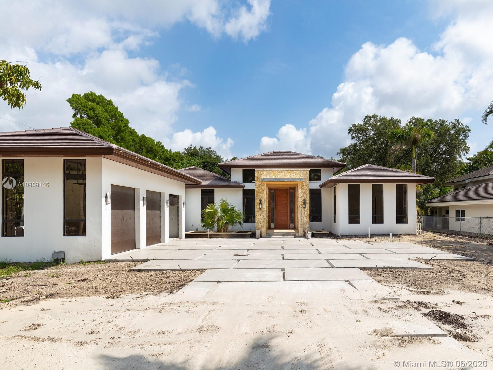 Magnificent New Construction Estate & ready for immediate occupancy in N Pinecrest. Residents will e