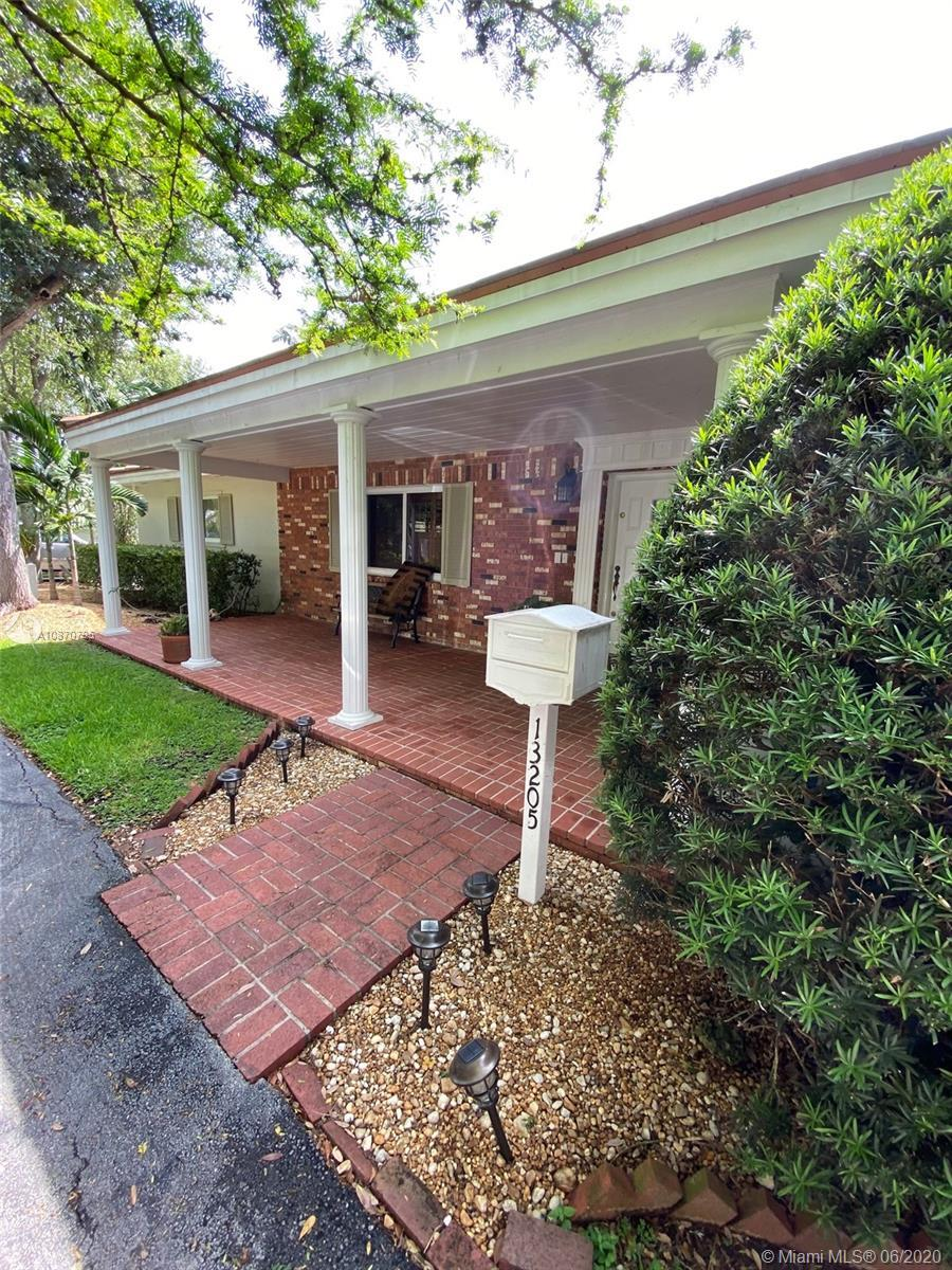 Beautiful canal front home in Pinecrest! Large four bedroom home on quiet street in a great area wit