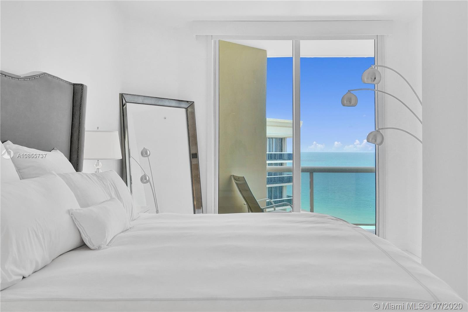 This bright and cheery furnished Penthouse w/10-foot ceilings and azure ocean views is 100% turnkey.