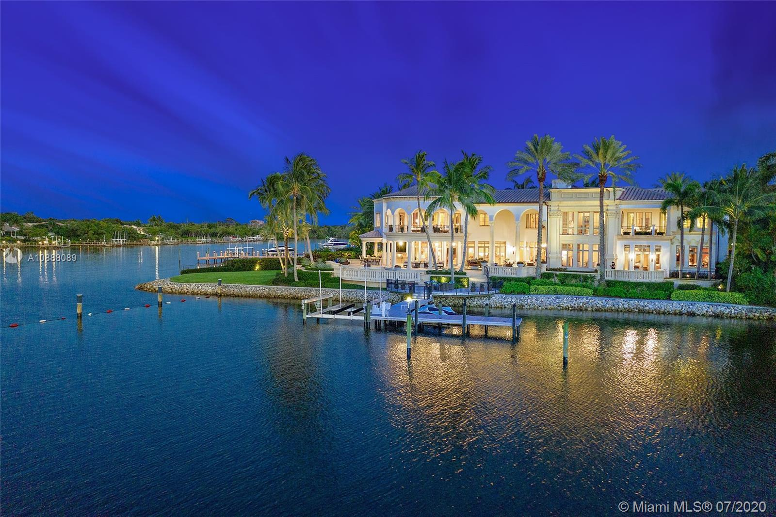 This stunning 5 BR, 7.1 BA Admirals Cove estate sits on over 220' of panoramic water frontage. The u