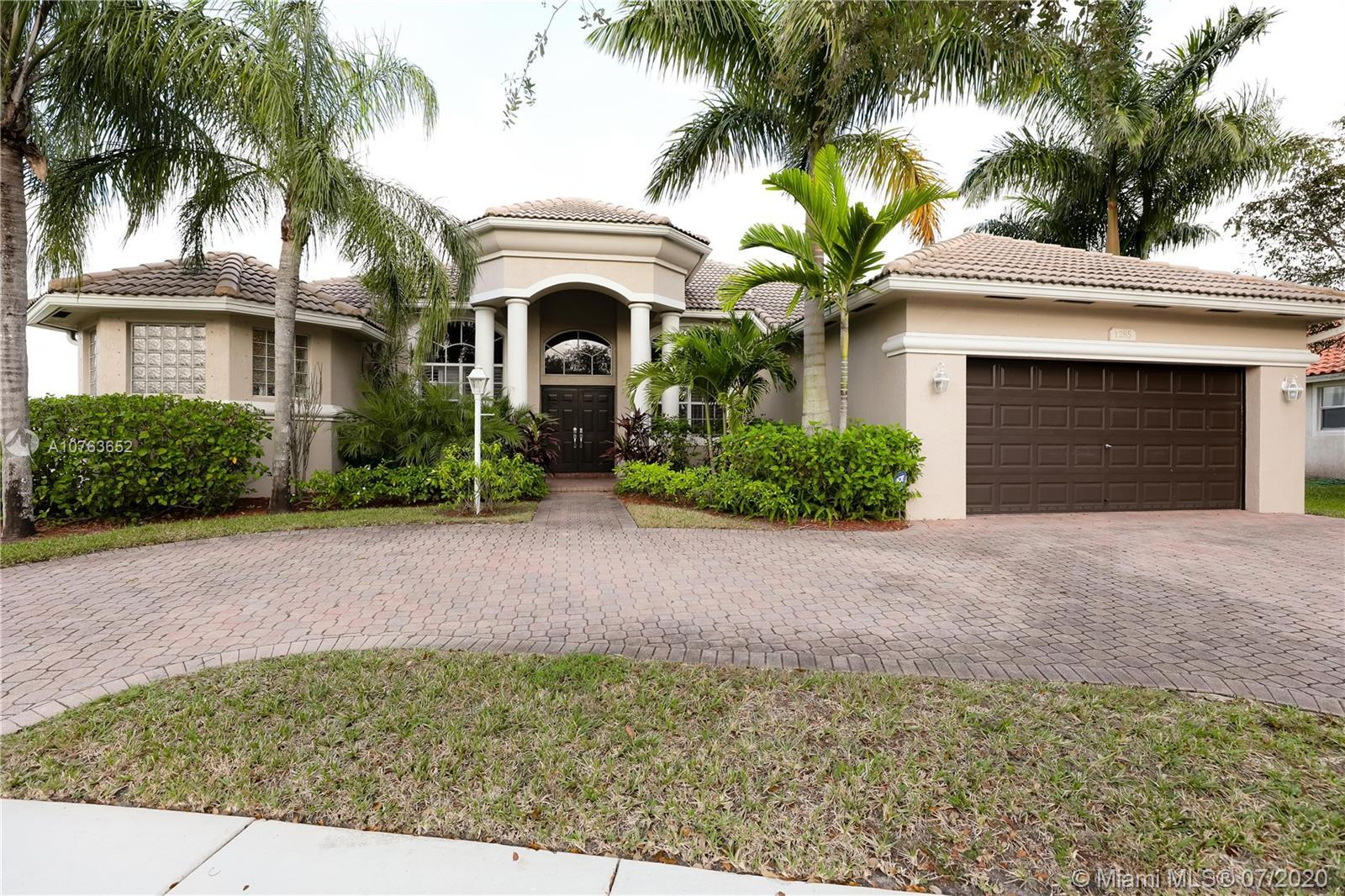 LOCATED IN THE DESIRED COMMUNITY OF PEMBROKE FALLS, THIS ONE STORY 4 BEDROOM HOUSE IS A SPECTACULAR