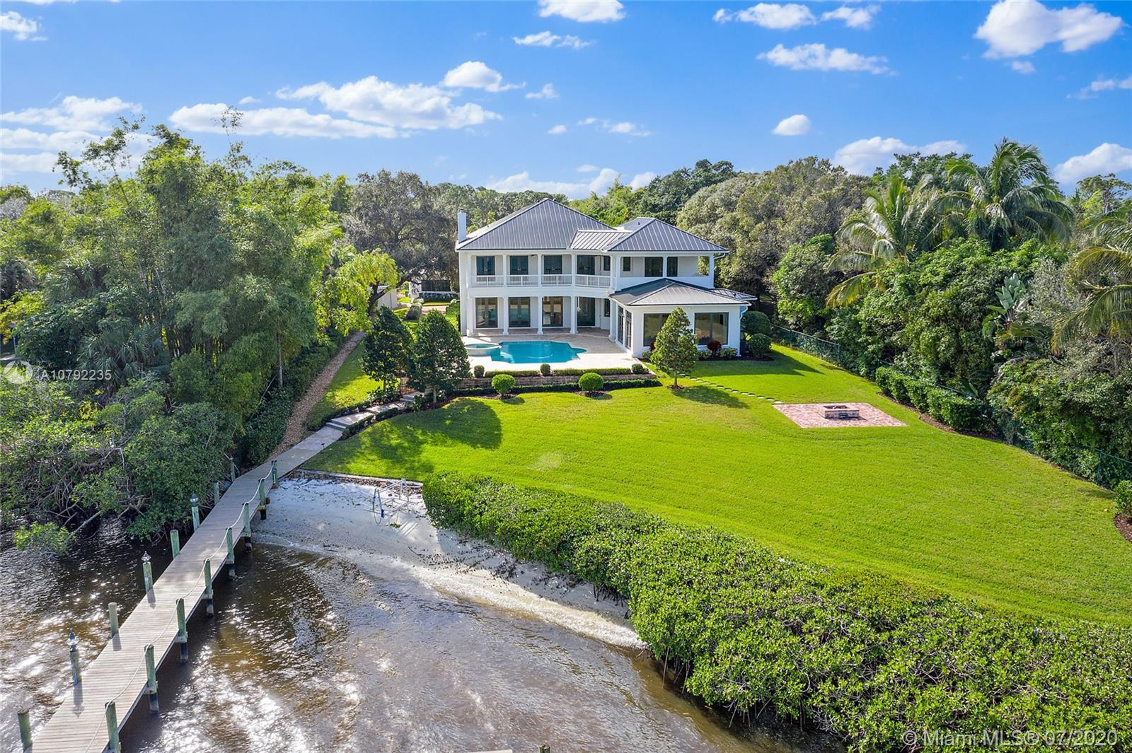 Magnificent Pennock Point grand private estate located on the Loxahatchee River with 144 ft. of fron