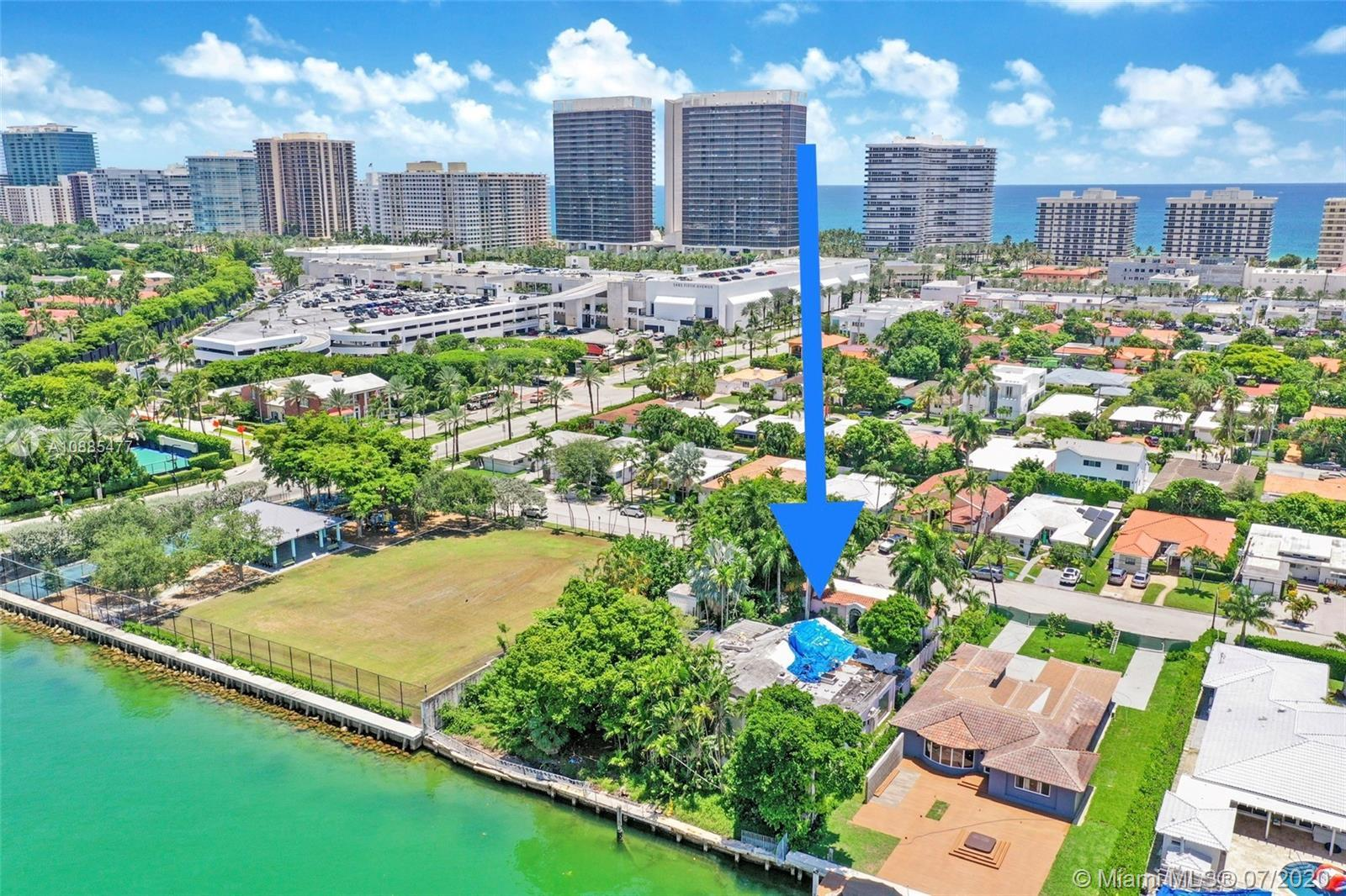Beautiful corner 22,750 sq. ft. waterfront home with 125' on the Biscayne Bay in highly desirable Su