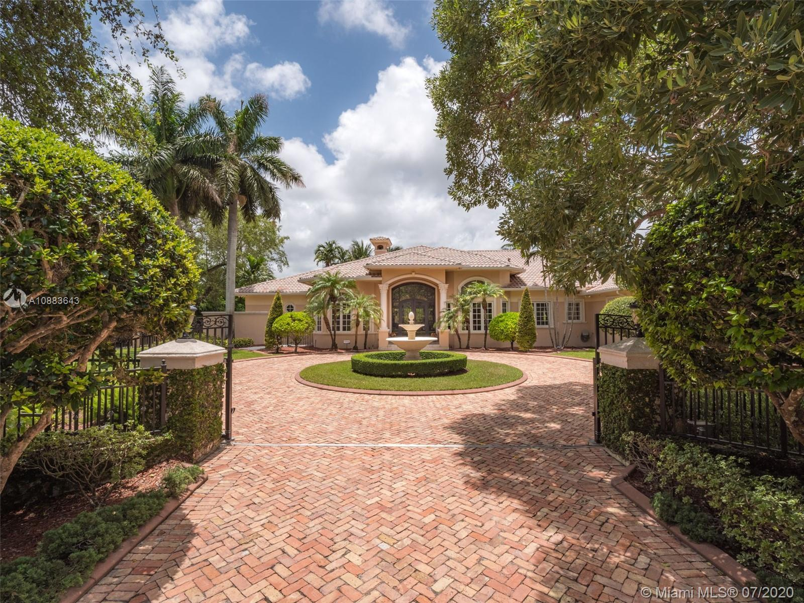 This custom Kenner gated estate sits on an acre lot surrounded by a canopy of lush trees that exudes