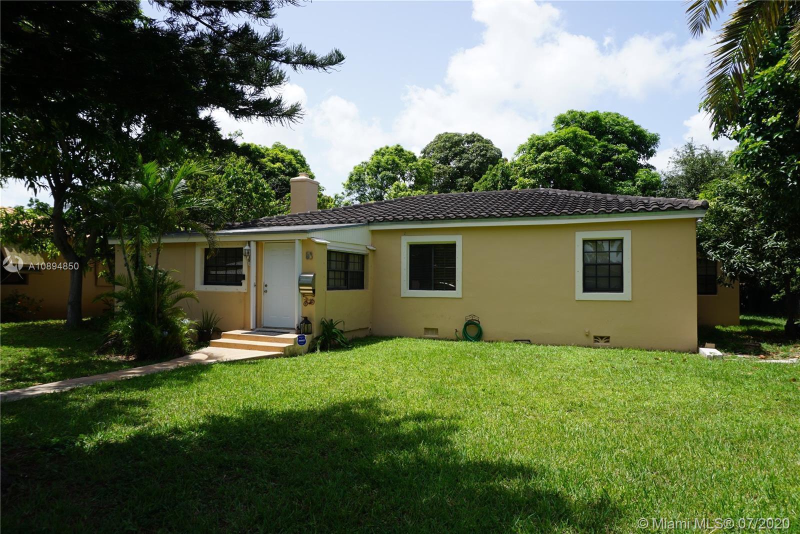 Beautiful Miami Shores 3 bdr 2 bth 1 car garage  Wide Center Island Landscaped Street Oak and Tile
