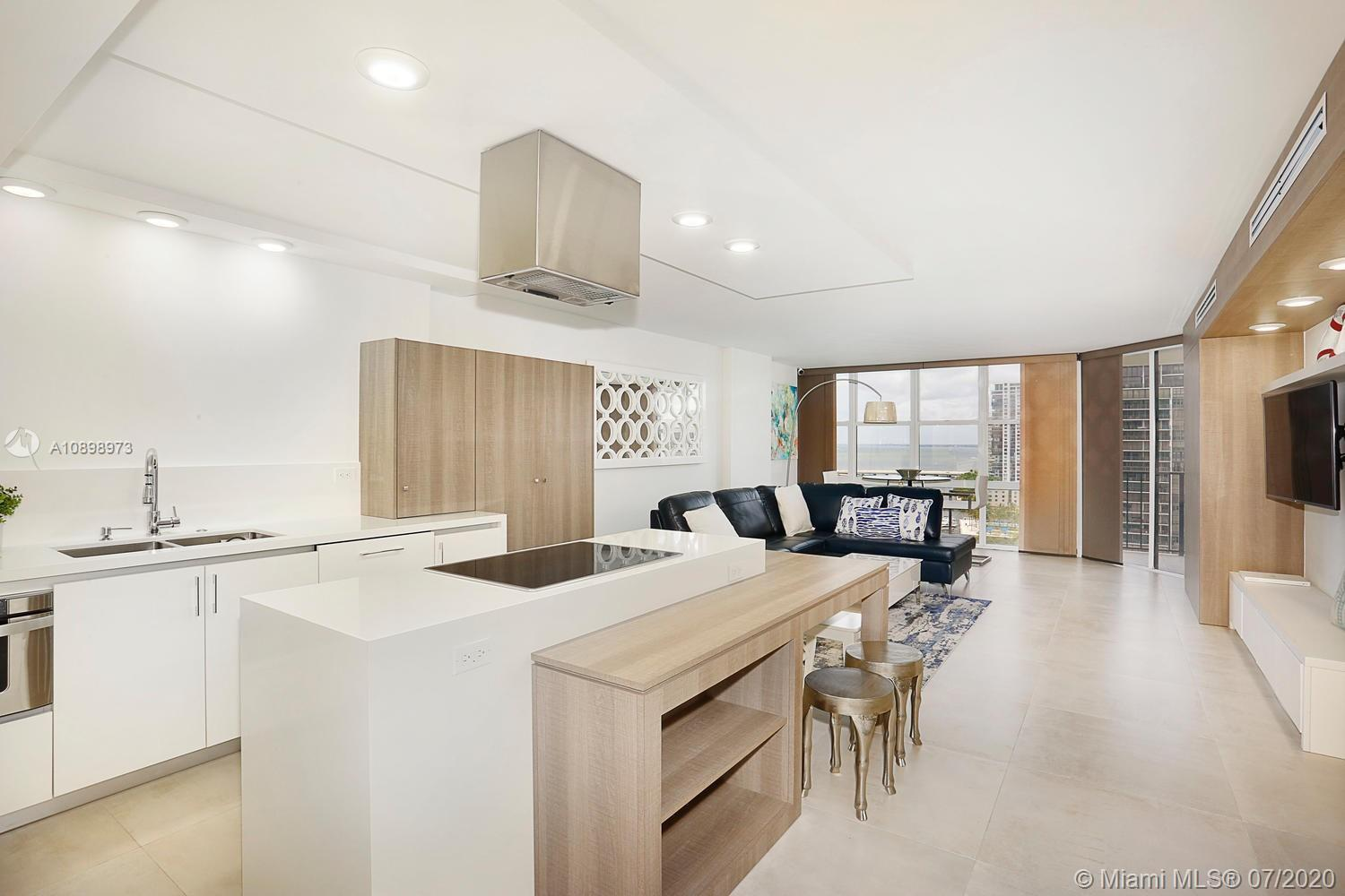 Beautifully renovated water view unit with new ceilings, lighting and floors was designed to welcome