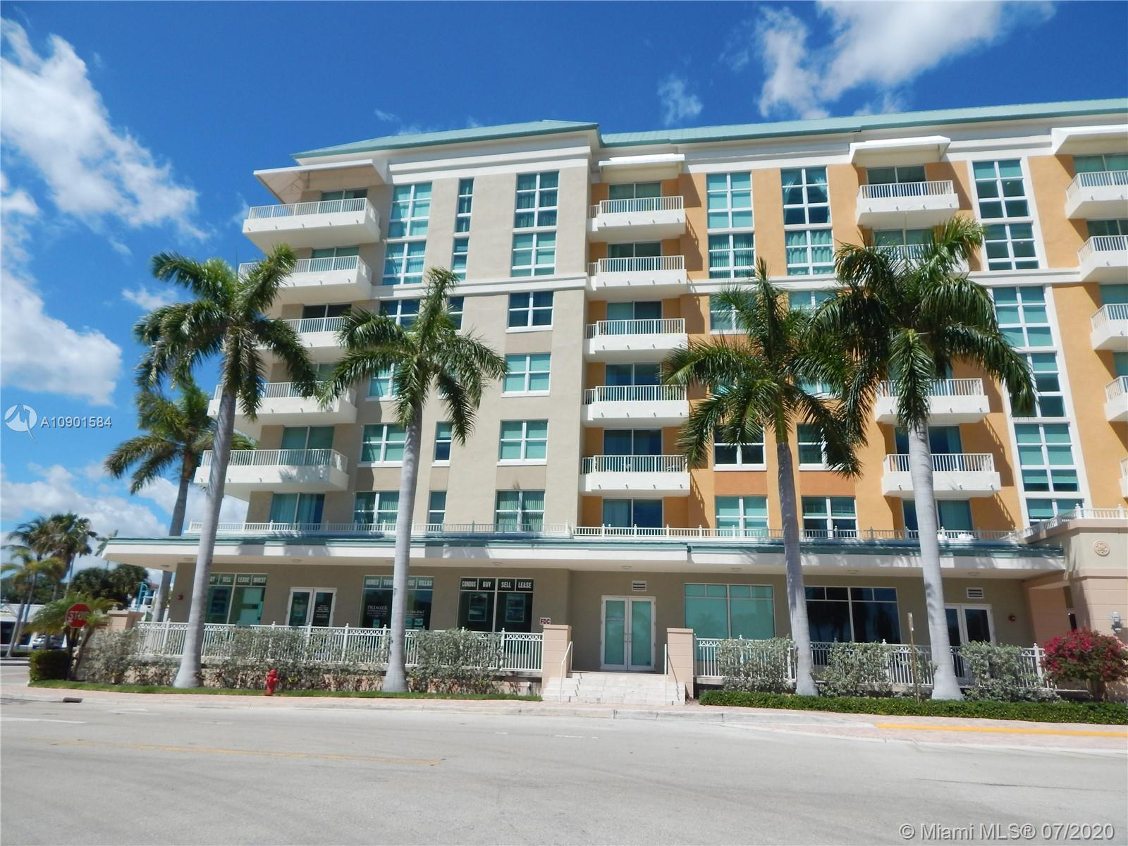 REMODELED CONDO, NEW KITCHEN, NEW BATHROOM, WOOD FLOORS, OPEN BALCONY WITH VIEW TO THE INTRACOSTAL,