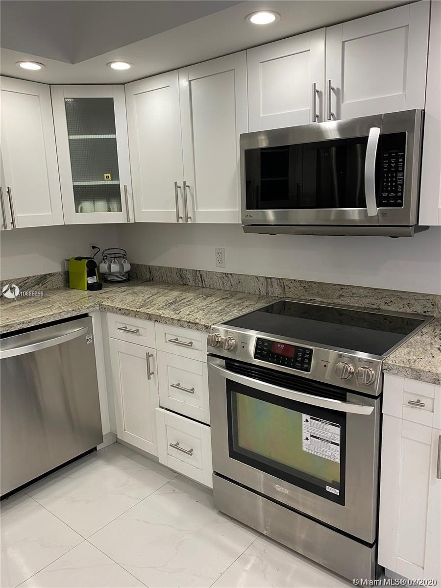 INCREDIBLE BRIGHTLY UNIT ALL REMODELED 2/2 W/PARTIAL OCEAN VIEWS FROM EVERY ROOM. BEAUTIFUL SPLIT PL