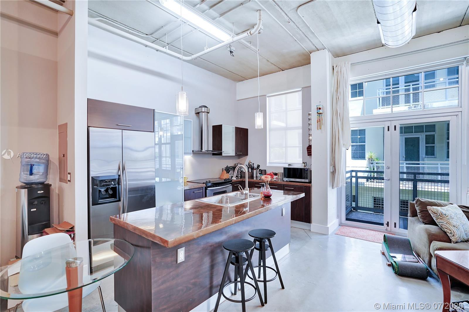 Beautiful and modern Loft featuring an expansive open floor plan with 12 ft ceilings, exposed duct work, polished concrete floors, stainless steel Kitchen Aid appliances, an upgraded bathroom, huge walk-in closet, hurricane impact windows, and window treatments. Avenue Lofts offers you a great location in the heart of the extremely popular Flagler Village area and transportation hub near downtown Fort Lauderdale. Building amenities include a rooftop pool, lounge, barbeque, and gym.  