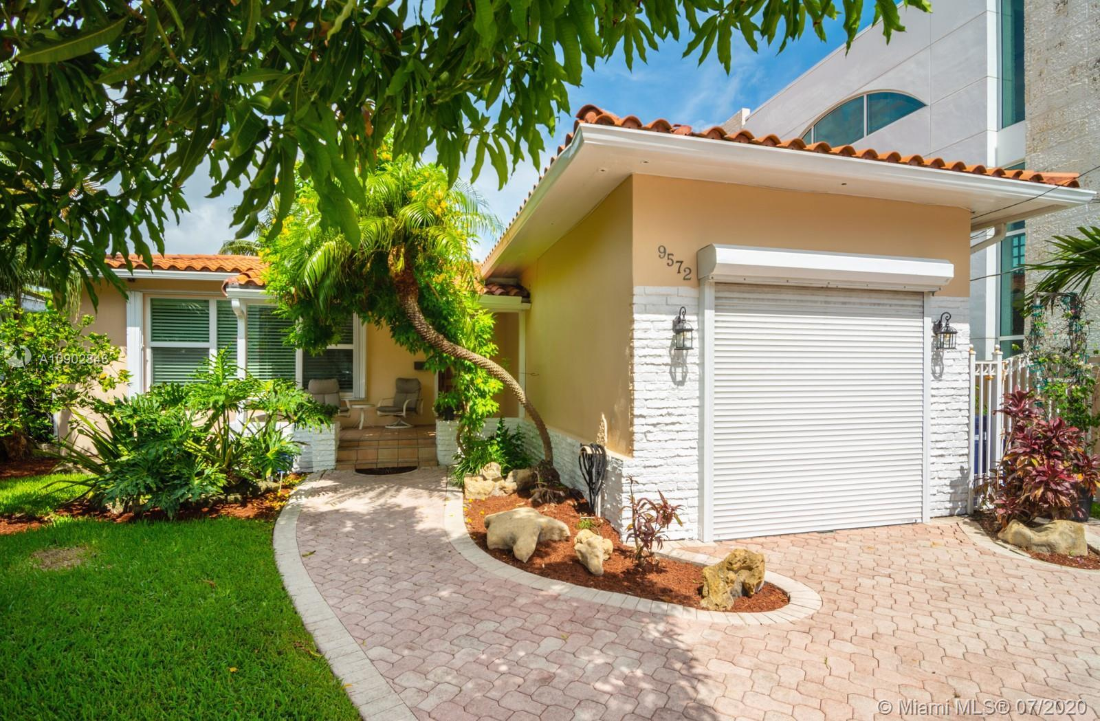 Stunning 3 bedroom 2 bath MIMO home steps to the beach-literally 1000 ft to the sand across from Bal