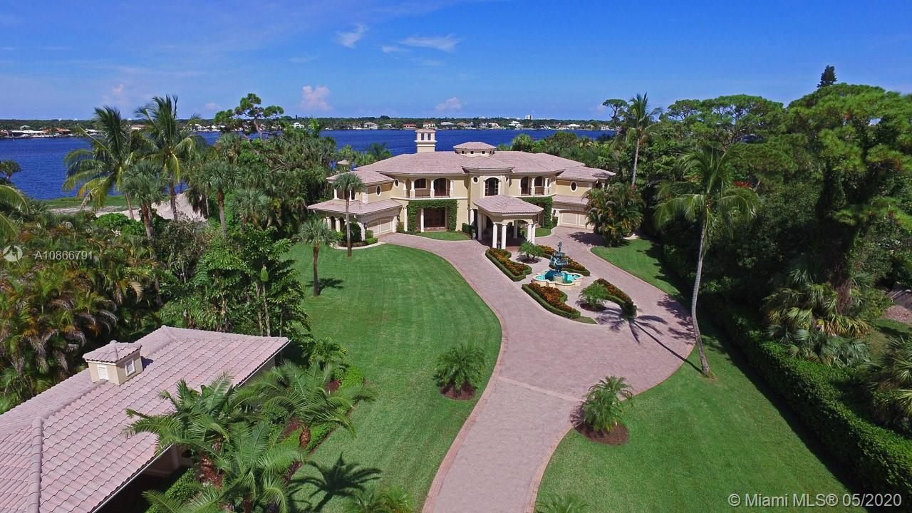 Palatial private gated Riverfront Estate on the Loxahatchee River. This elegant home sits on 1.72 ac