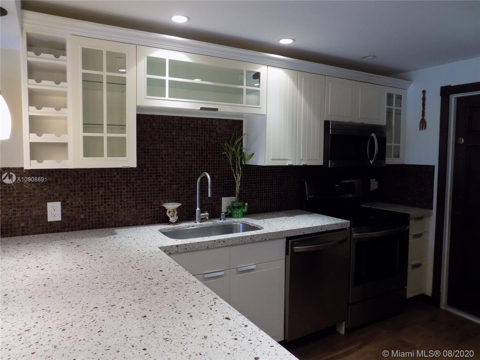Beautiful corner completely remodeled apartment in Palm Aire Country Club. 3 bedrooms, 2 bathrooms,