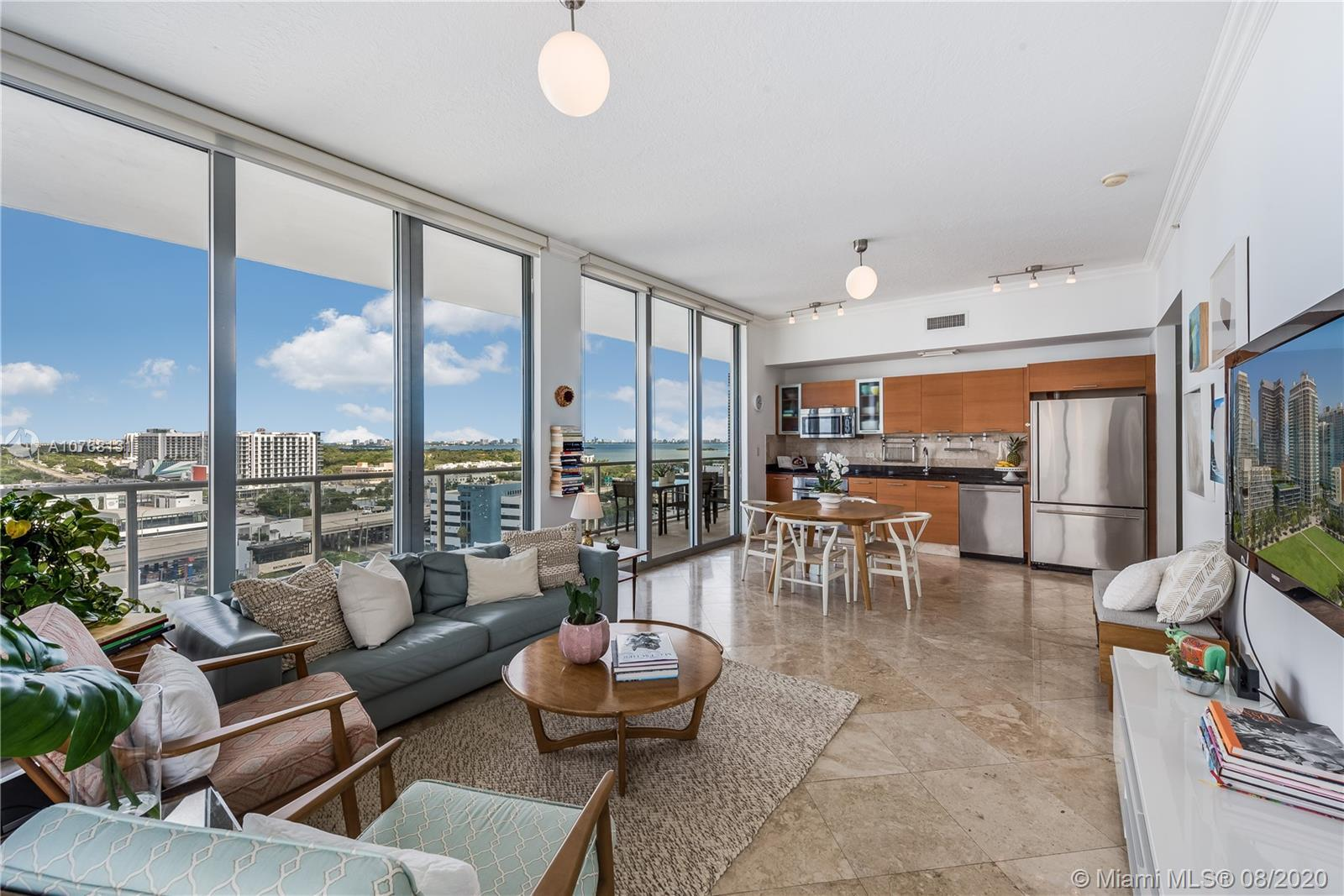 Enjoy breathtaking views of Biscayne Bay from this 3 Bed / 2 Bath residence perched above the Miami