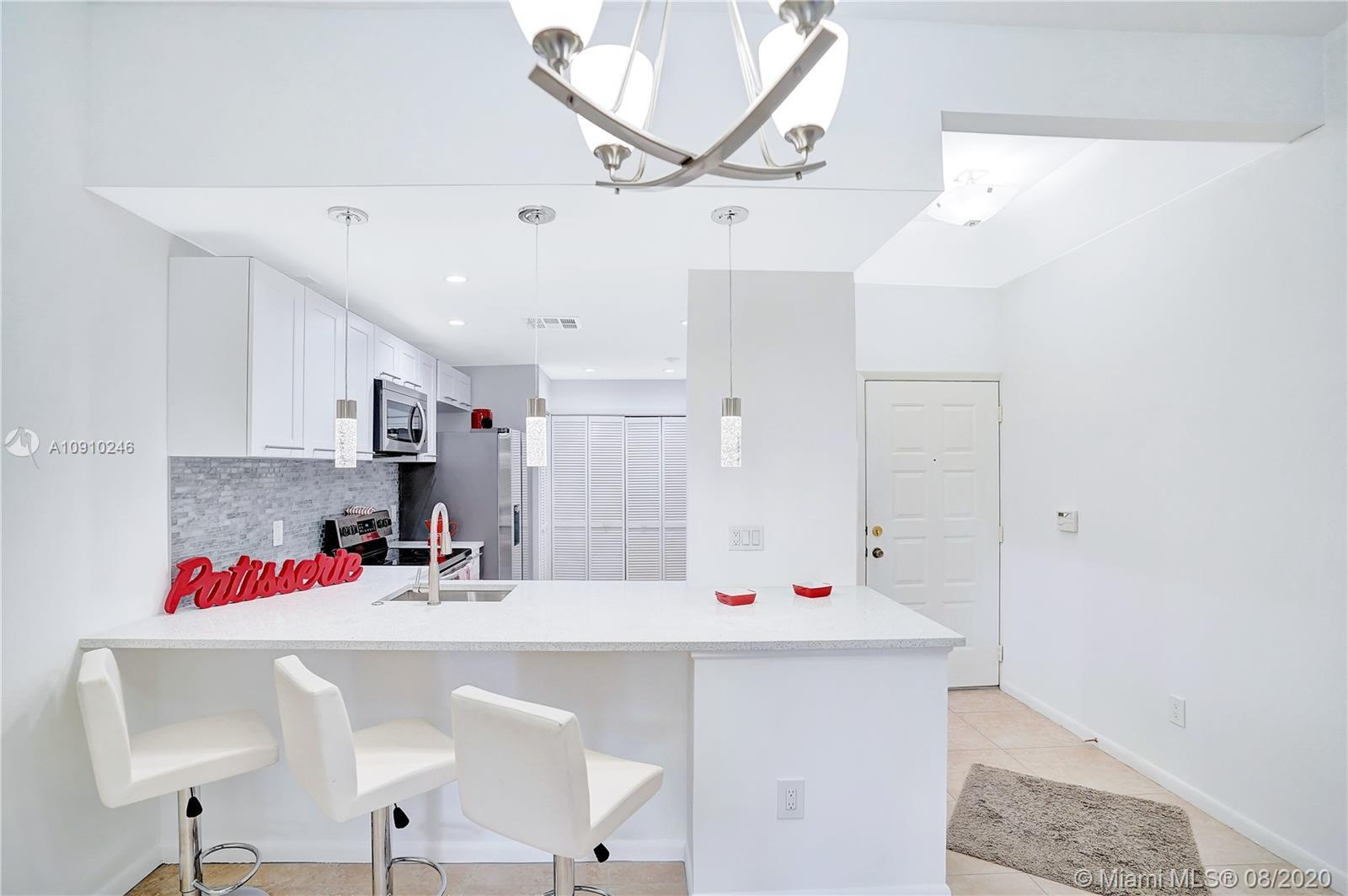 Beautifully renovated first-floor condo with lake & Golf view is a must-see. Located in the prestigi
