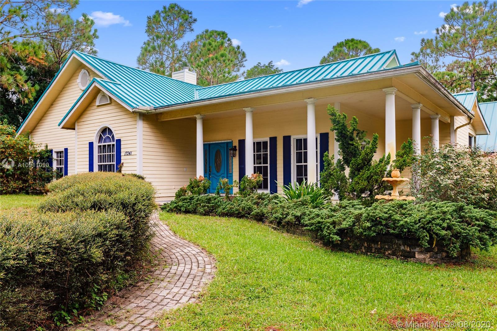 CUSTOM BUILT HOME ON 1.25 ACRES IN JUPITER FARMS. This home was built on a solid concrete slab with